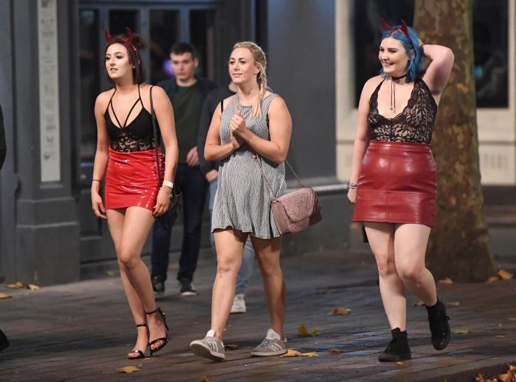 Girls were keen to match their outfits for the night out, with these friends donning red leather skirts and lacy red tops