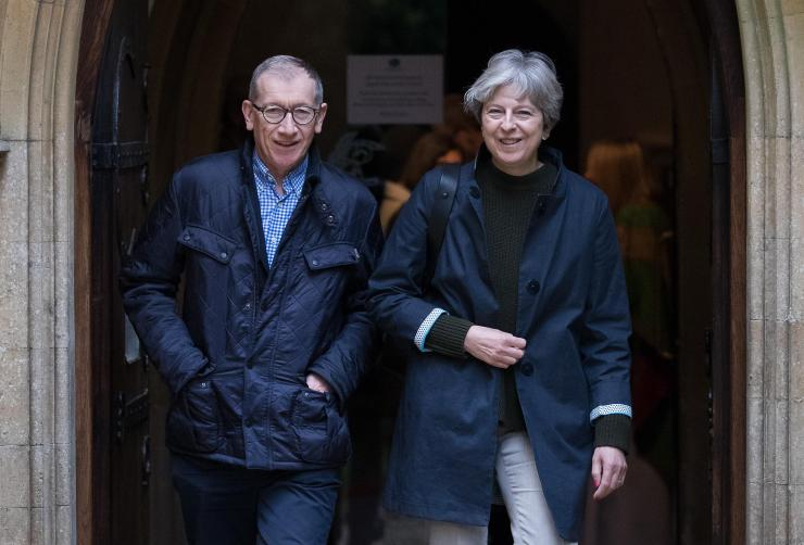 Theresa May, pictured with husband Philip today, is investigating the allegations