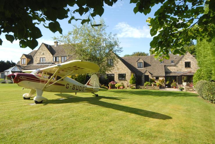 A £1.5million home is being offered with a 1953 Piper Pacer aeroplane.