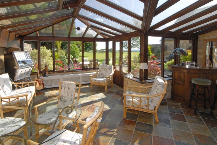 The £1.5million country pile has a conservatory with the plane parked in the garden
