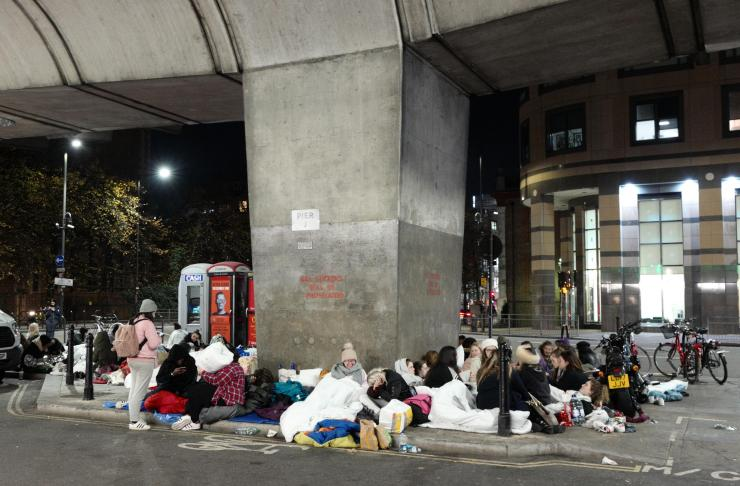 Their ad hoc sleeping arrangements are spread all across the pavement outside the Hammersmith Apollo