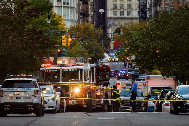 As dusk fell over the city, dozens of emergency vehicles remained at the scene