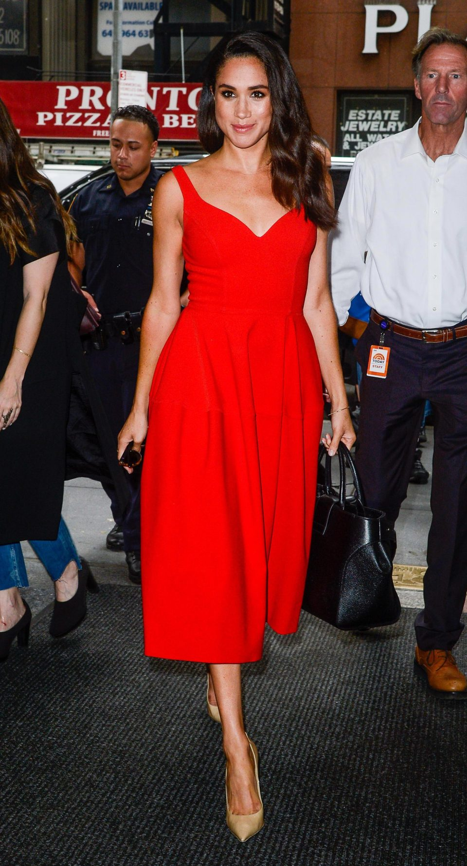Since getting serious with Harry, Meghan has been spotted in more conservative looks