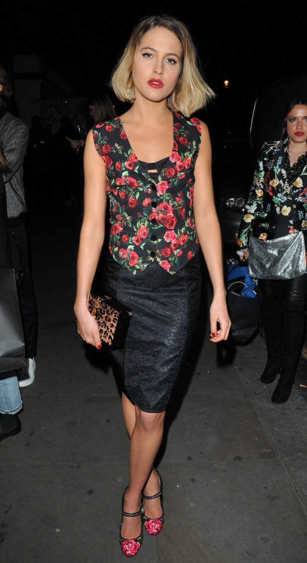 Tess Ward dazzled in a floral waistcoat and a leather pencil skirt