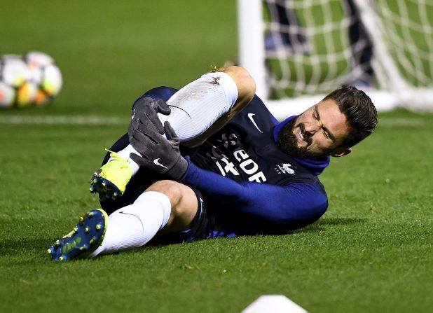 Olivier Giroud was in a lot of pain as he clutched his lower leg after being injured in France training