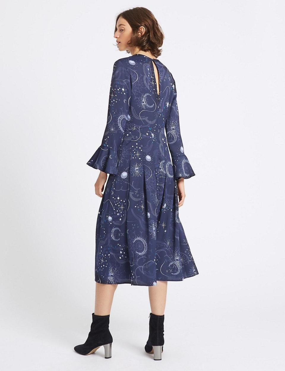 The cosmic girl frock features fluted sleeves and a nipped in waist