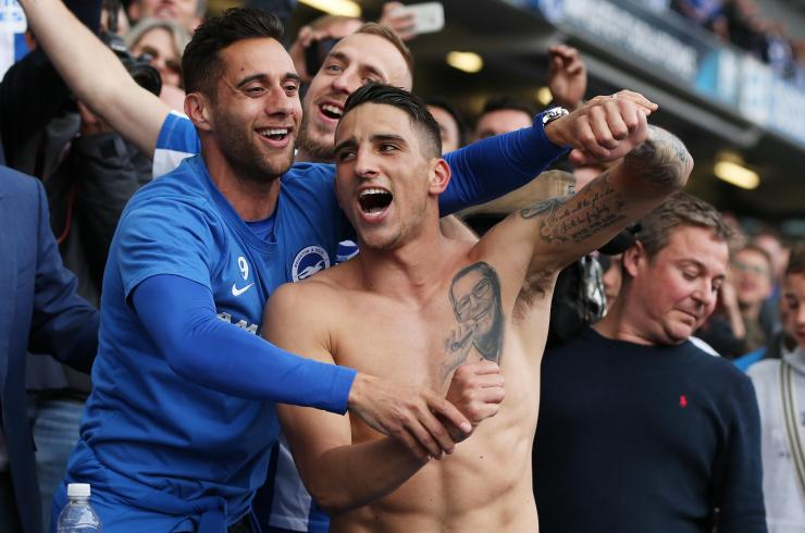 Anthony Knockaert celebrates promotion to the Premier League with Brighton