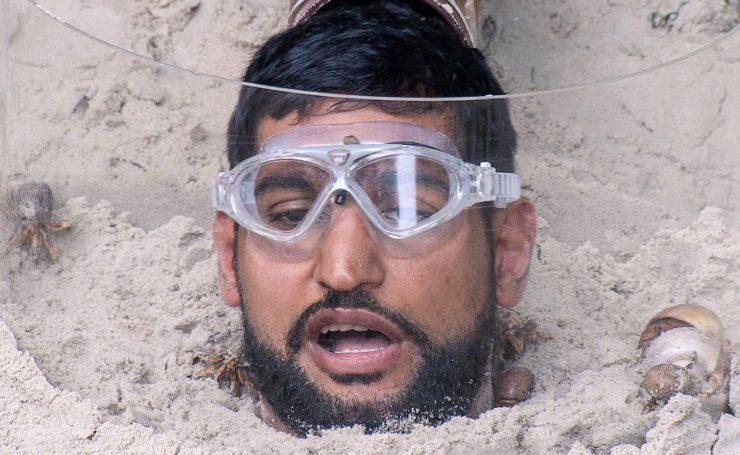 Amir was submerged in sand during one trial
