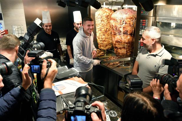 nintchdbpict000376462149 - Ex-Arsenal star Lukas Podolski opens his own kebab shop and fans queue for FIVE HOURS to get a bite