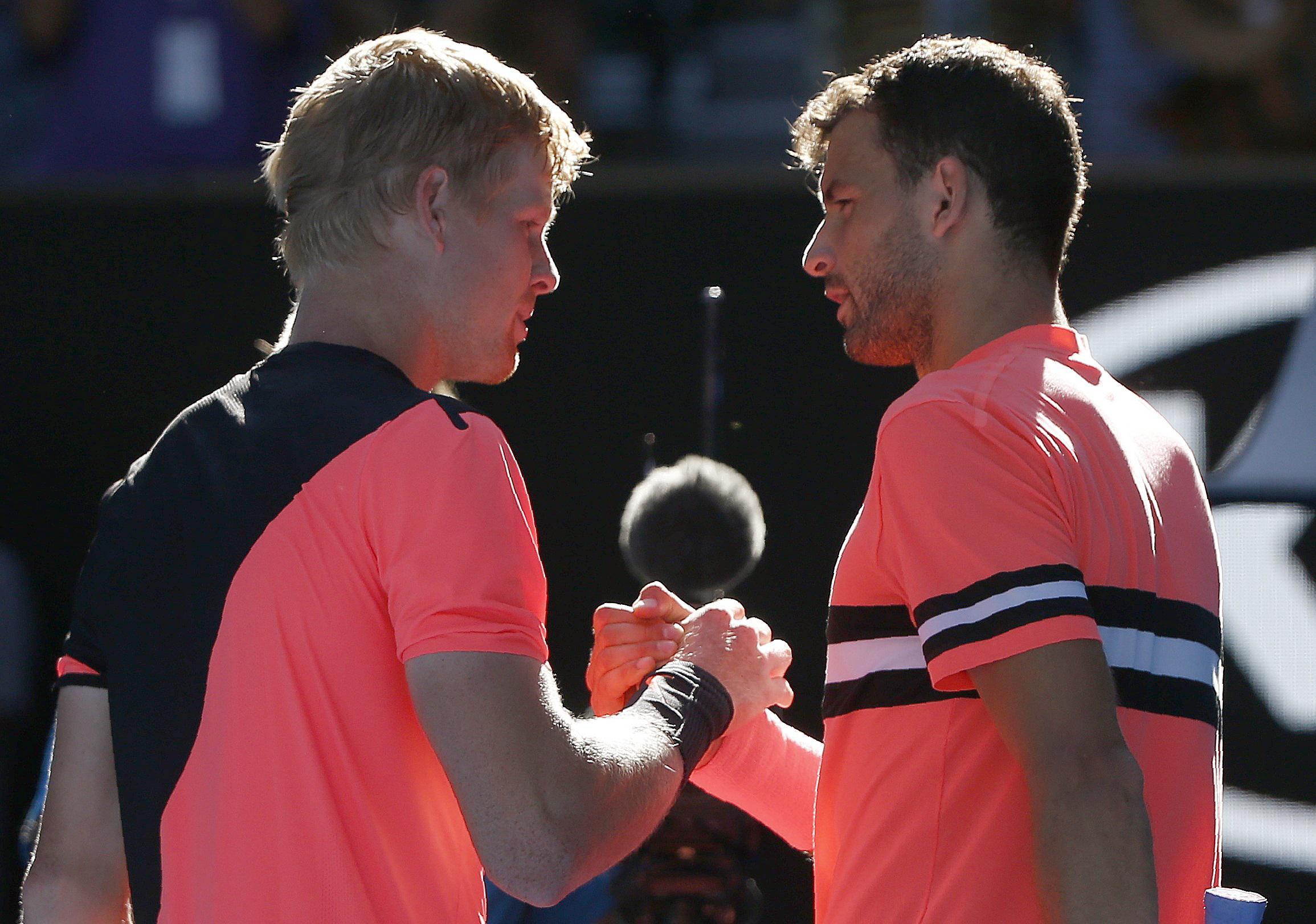 Grigor Dimitrov congratulates Kyle Edmund on victory in the Australian Open quarter finals
