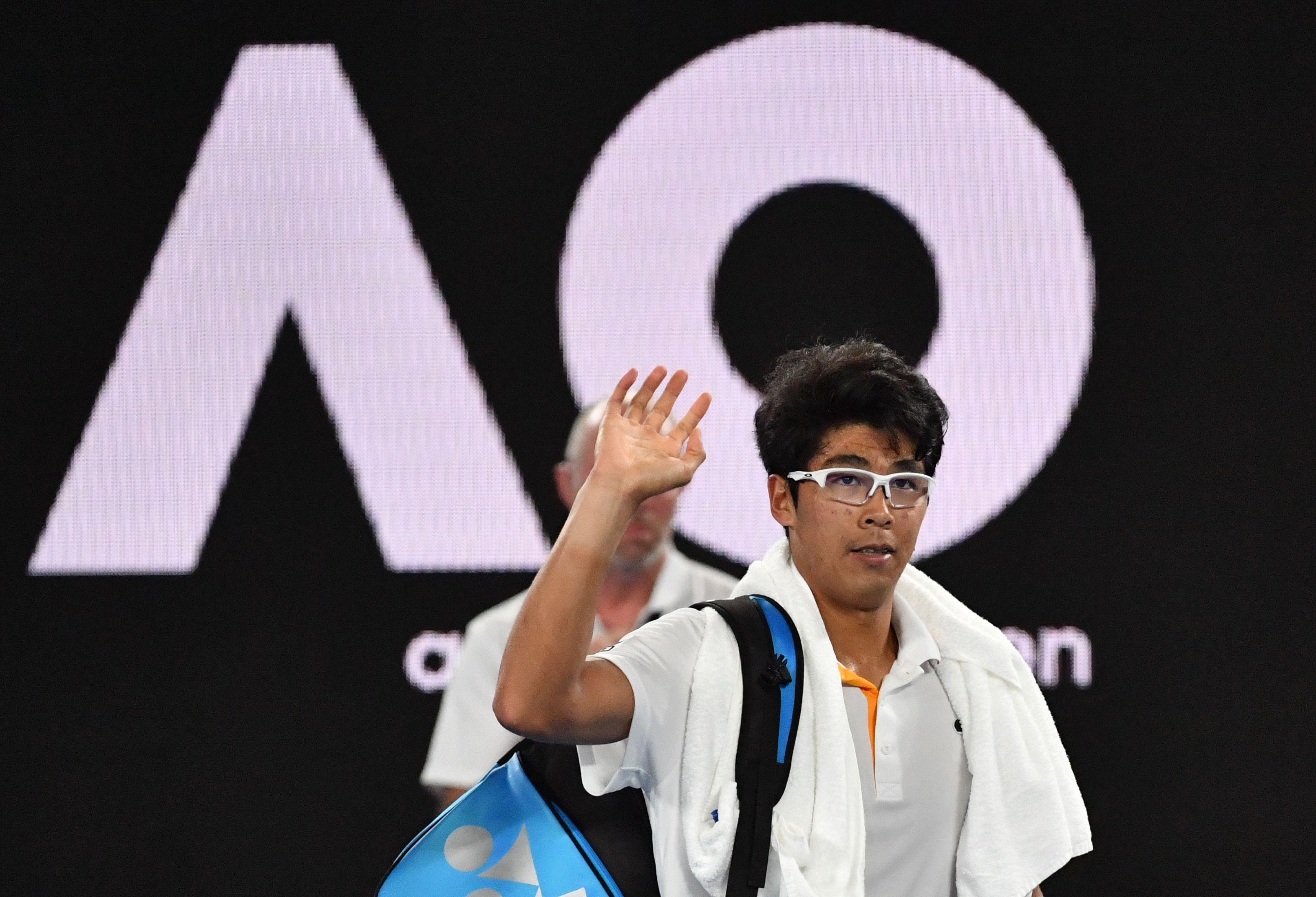 Chung Hyeon waves to crowd following retirement due to blisters