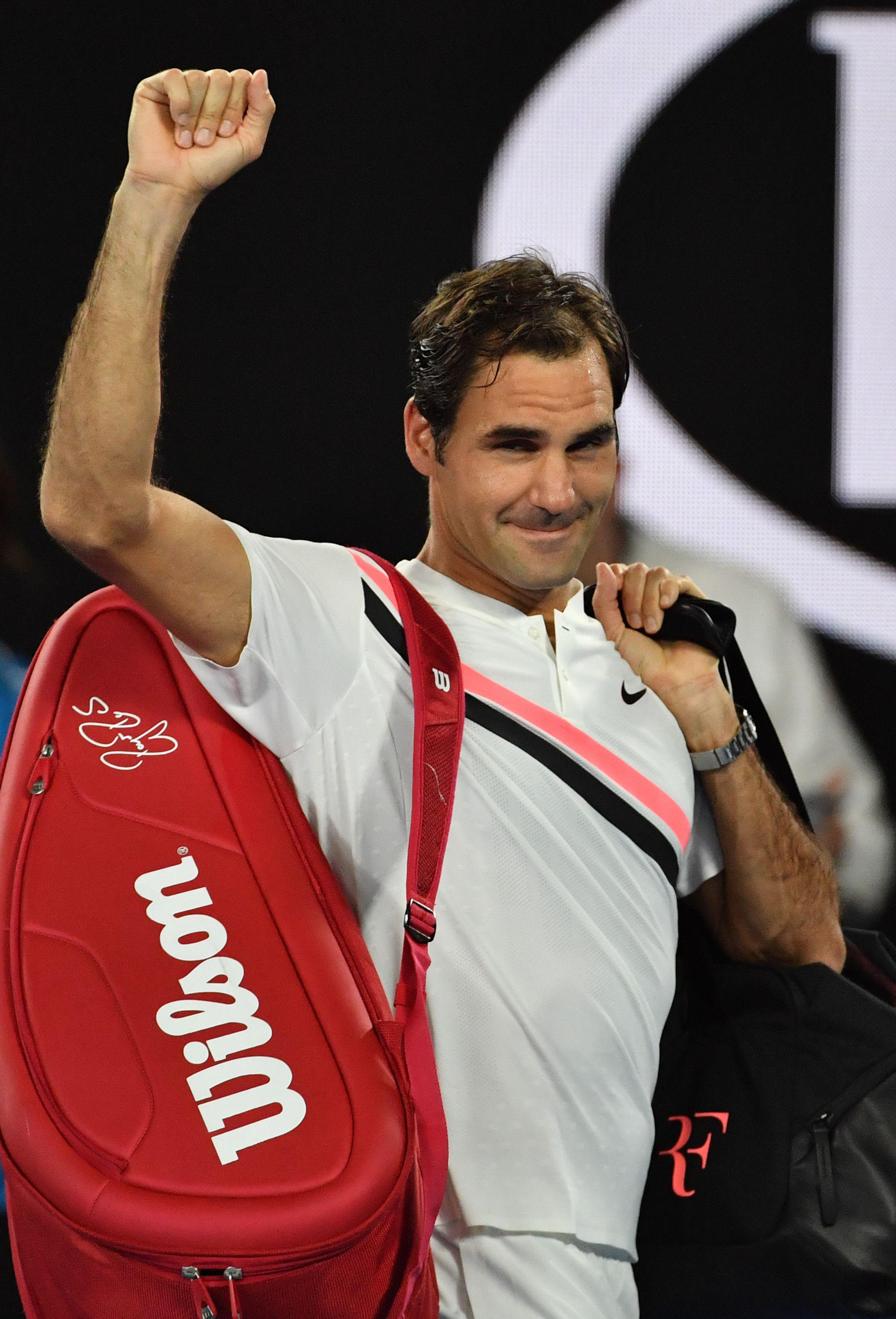 Roger Federer looks almost embarrassed as he celebrates win in Melbourne