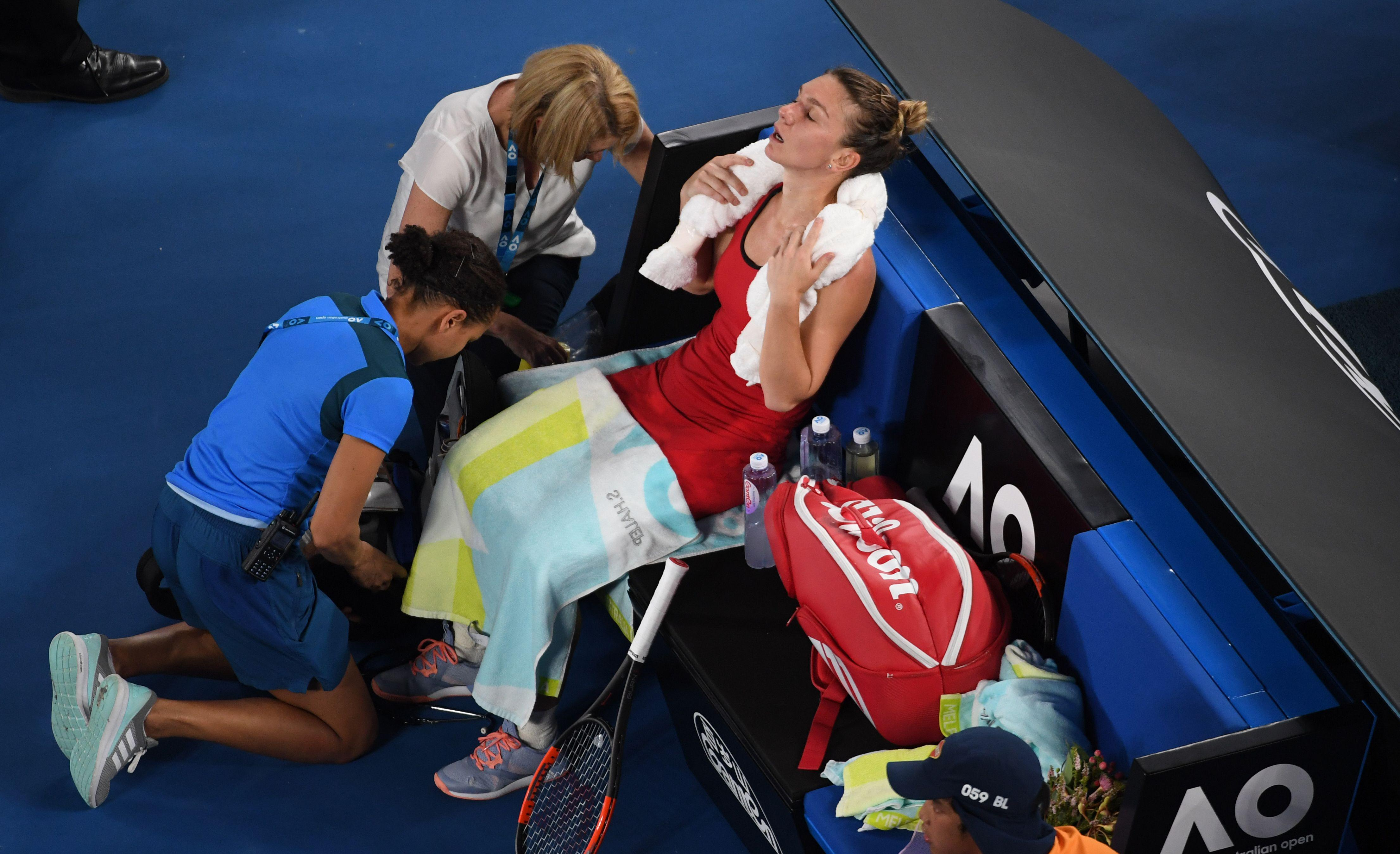 Simona Halep receives medical help during Australian Open final