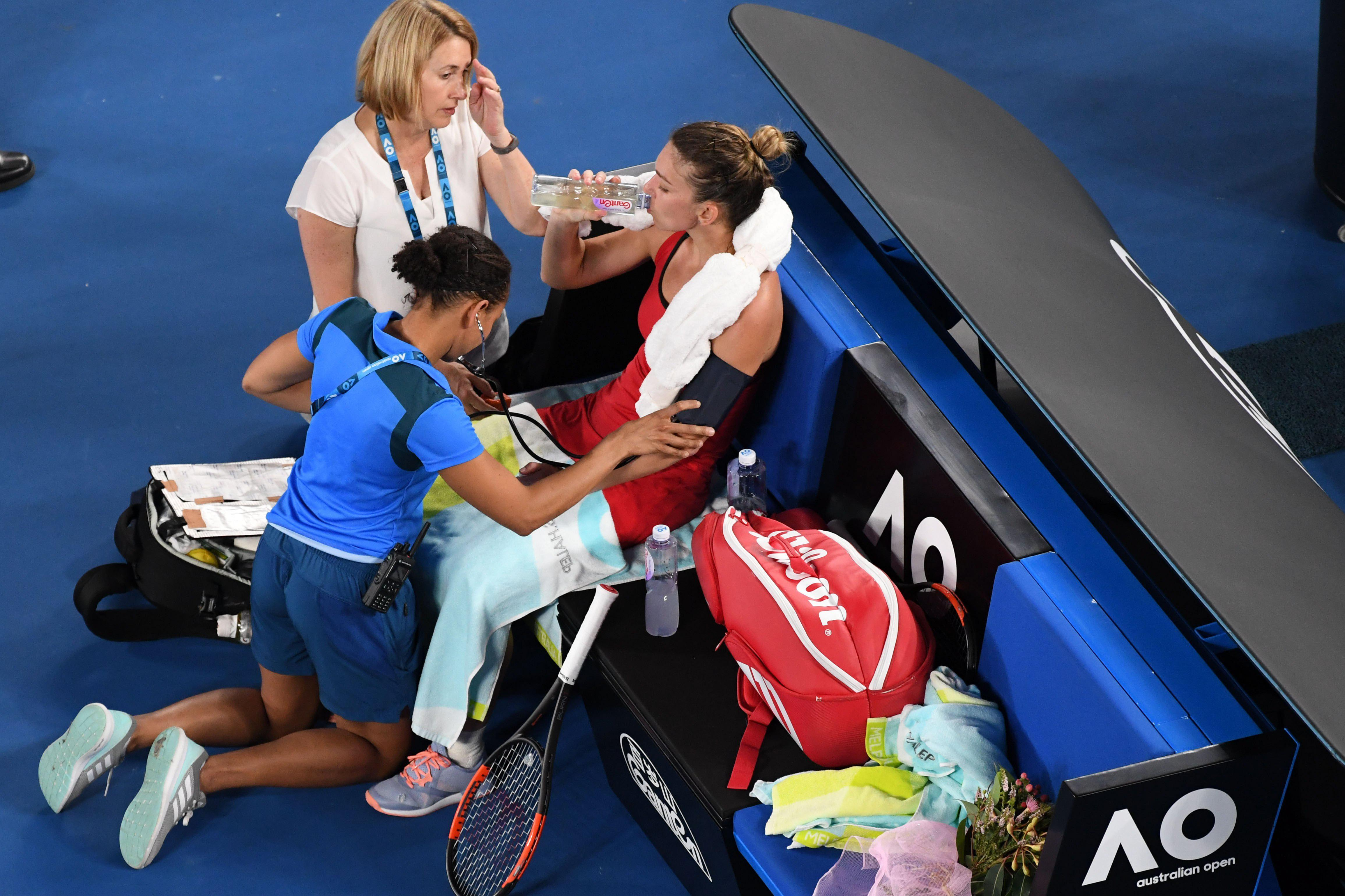 Doctors came on to the court to see to the Romanian but she managed to spring to her feet and get on with it