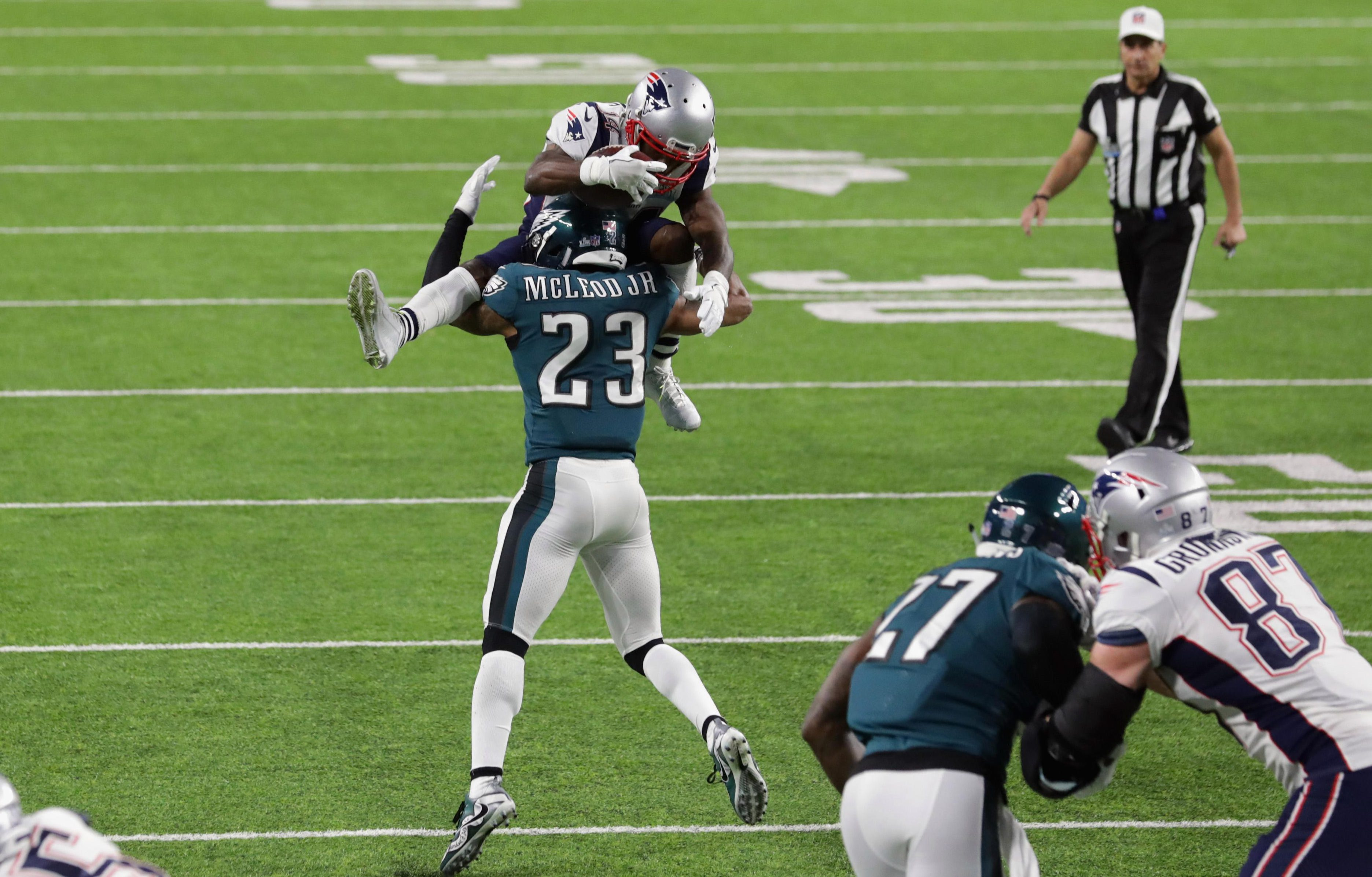 Rodney McLeod tackles an airborne Brandin Cooks