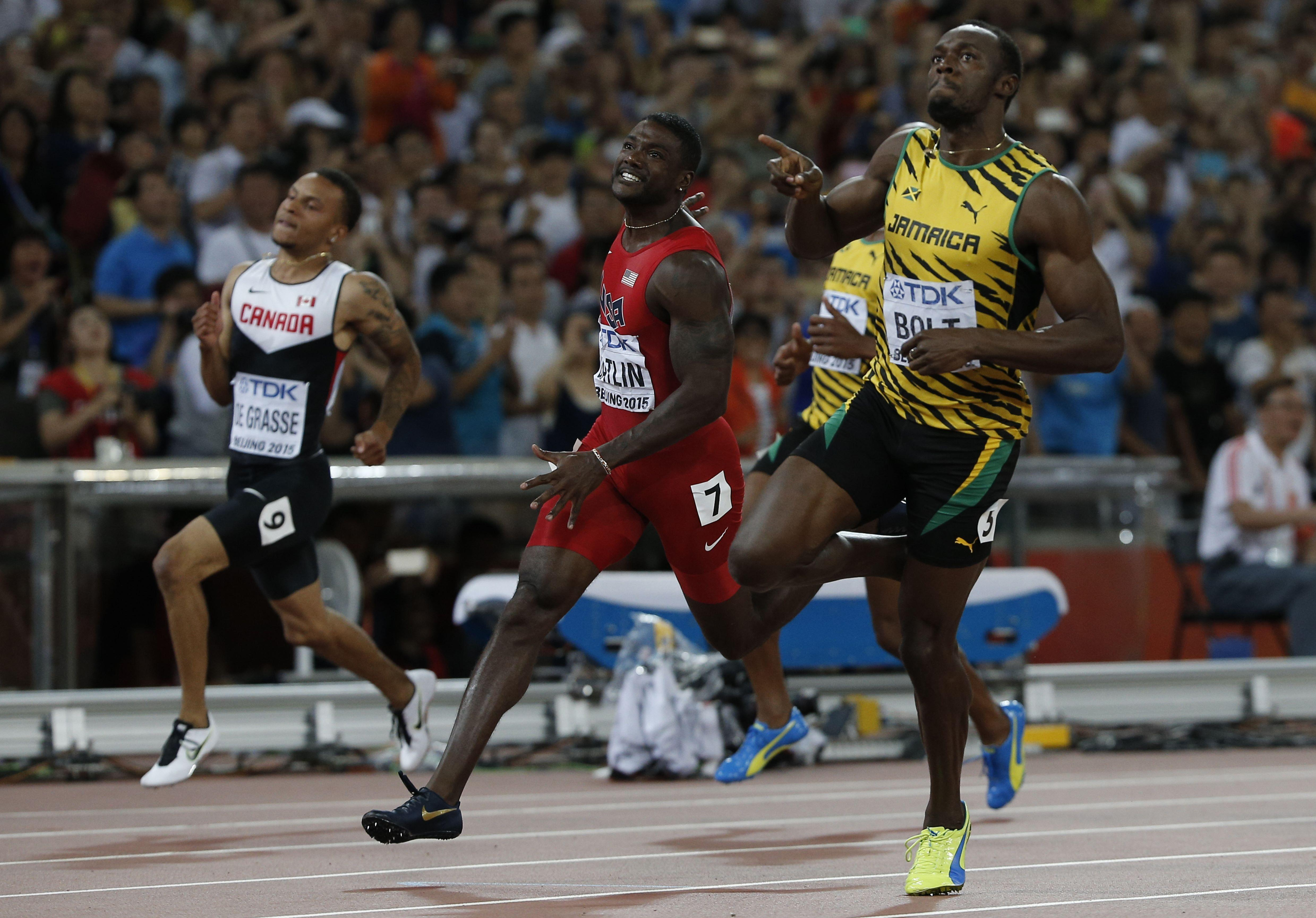Usain Bolt, right, will not be involved in the Commonwealth Games, but Andre de Grasse, left, is tipped to run