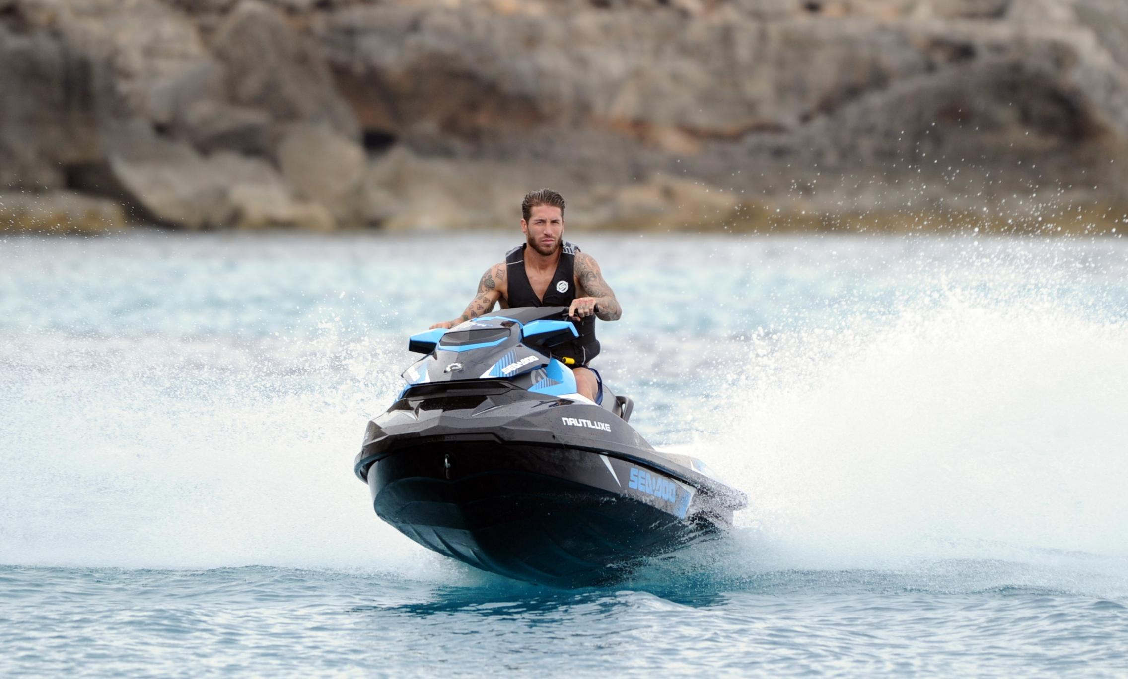 Sergio Ramos takes a break from the yacht for a jet-ski ride