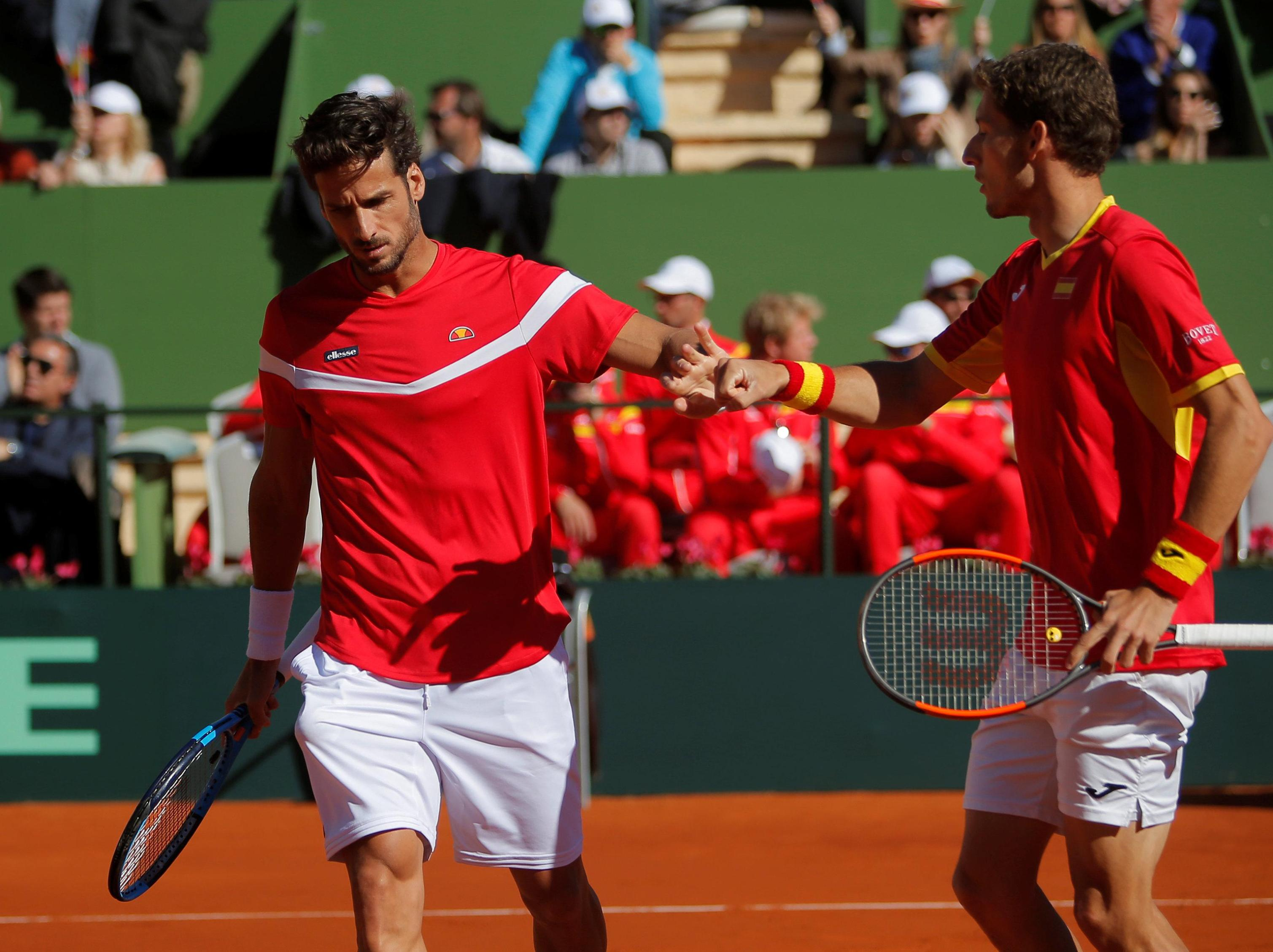 Pablo Carreno Busta and Feliciano Lopez celebrate during their doubles match against Great Britain's Dominic Inglot and Jamie Murray.