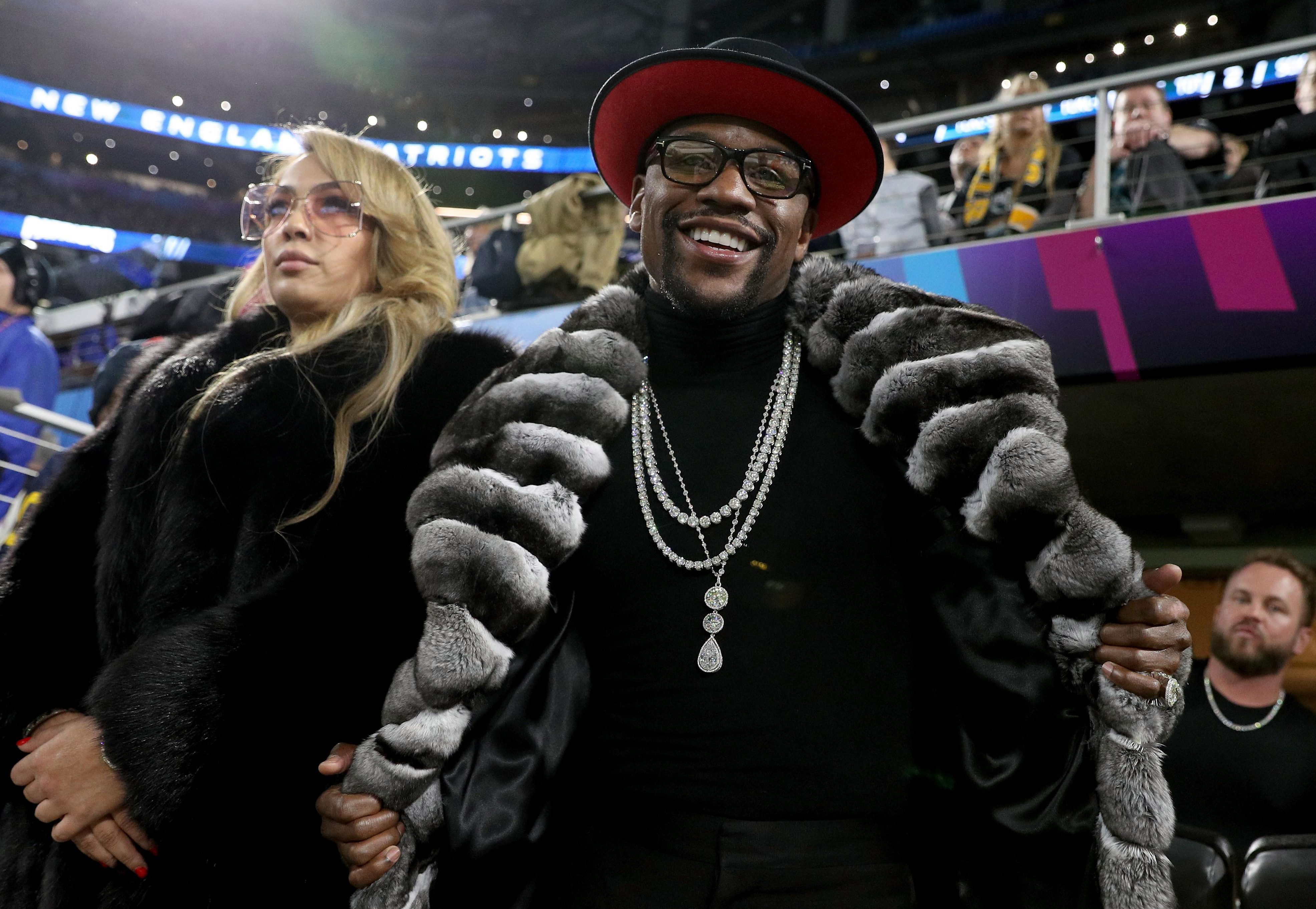 Floyd Mayweather flaunted his wealth at the Super Bowl with flash fur coat