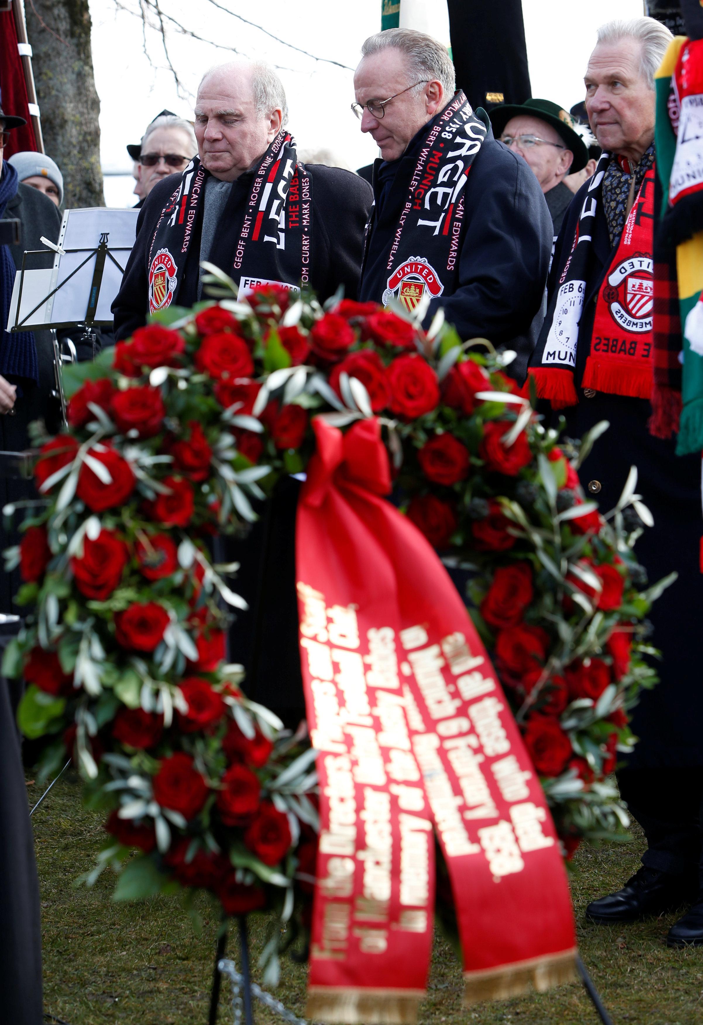 Bayern Munich CEO Karl-Heinz Rummenigge bows his head at Manchesterplatz, Munich where a memorial service was held for the tragedy
