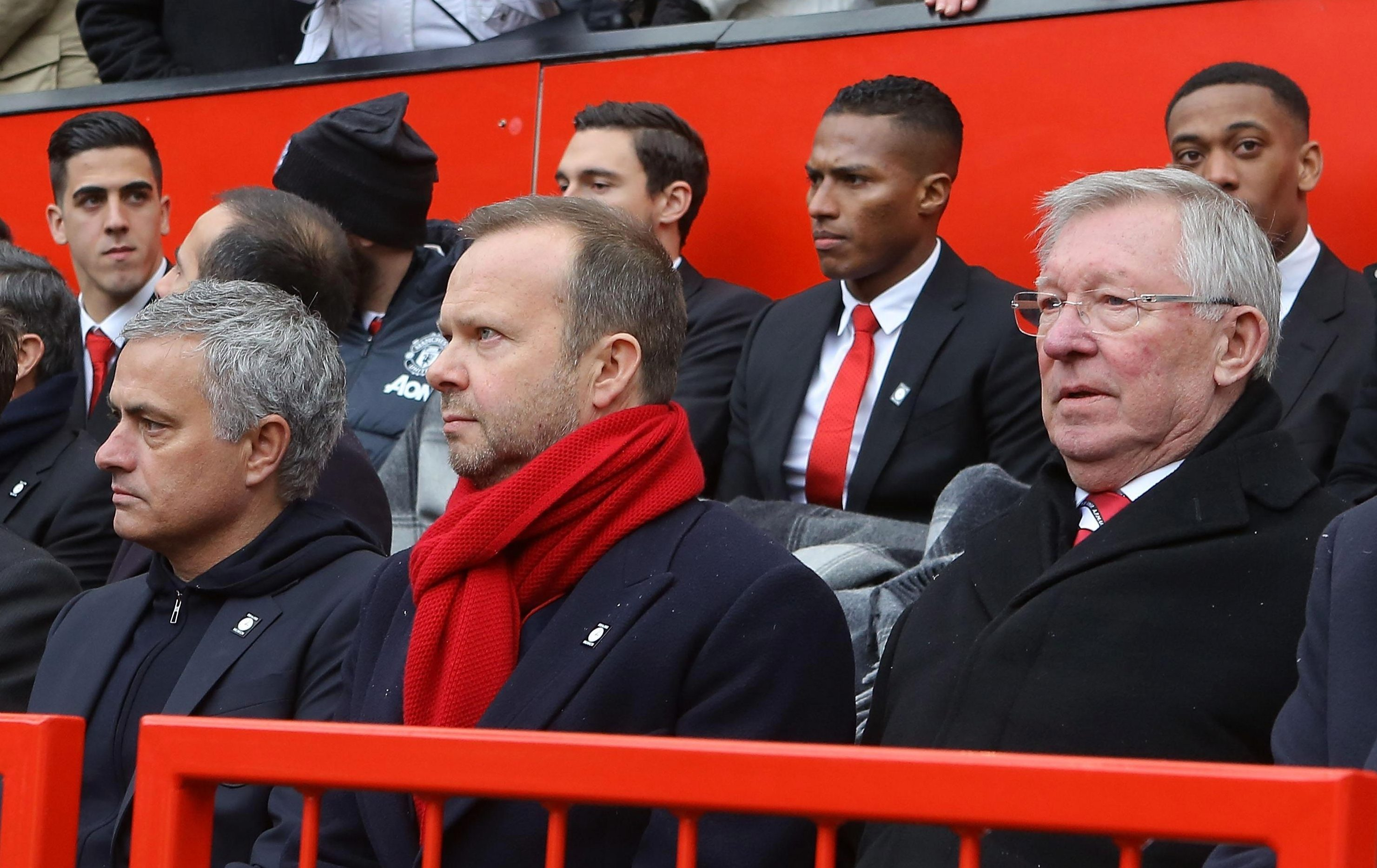 United's players can be seen behind Ed Woodward and Alex Ferguson at the service