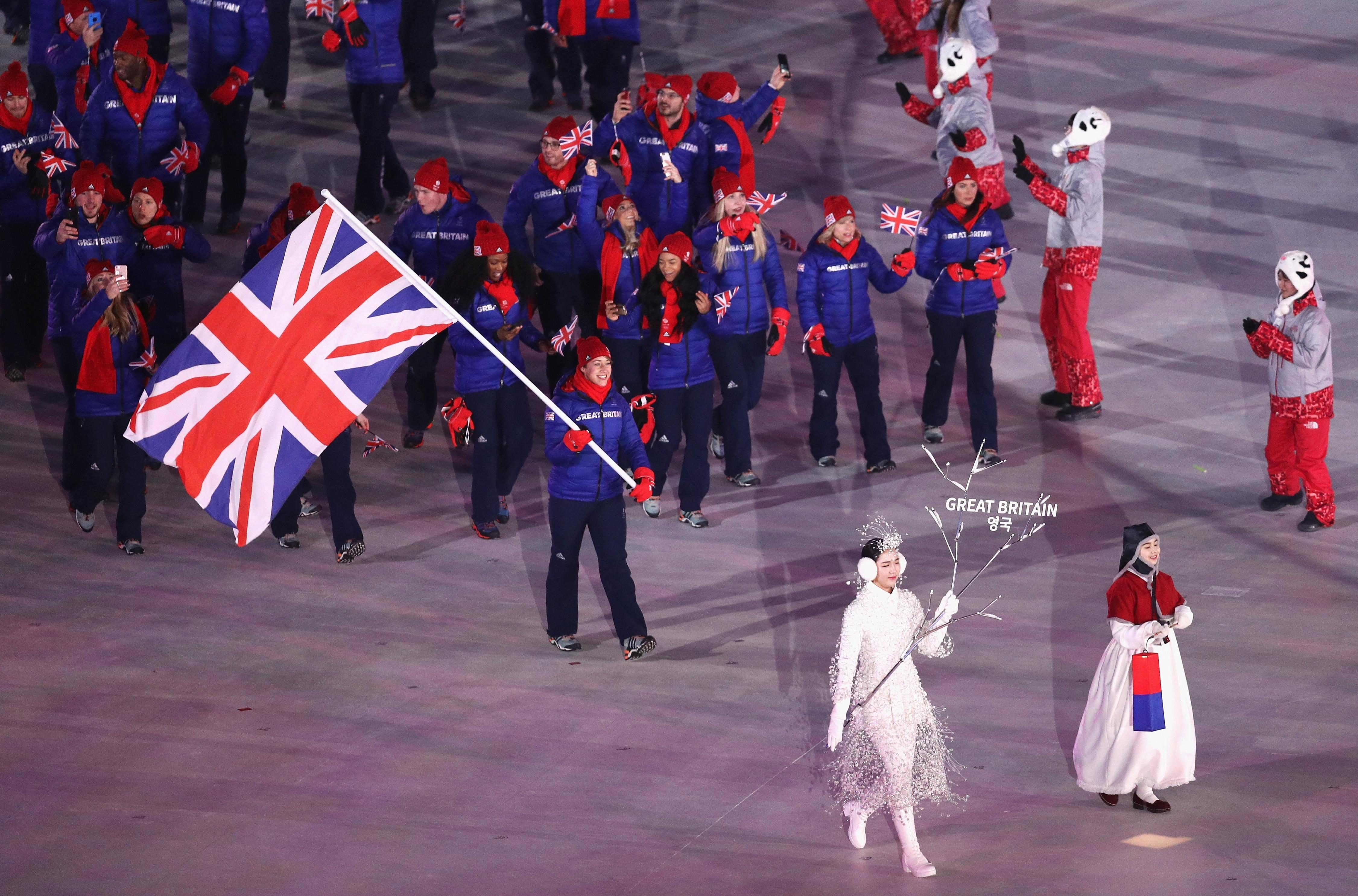Lizzy Yarnold proudly flies the flag for Team GB at the opening ceremony of the Winter Olympics