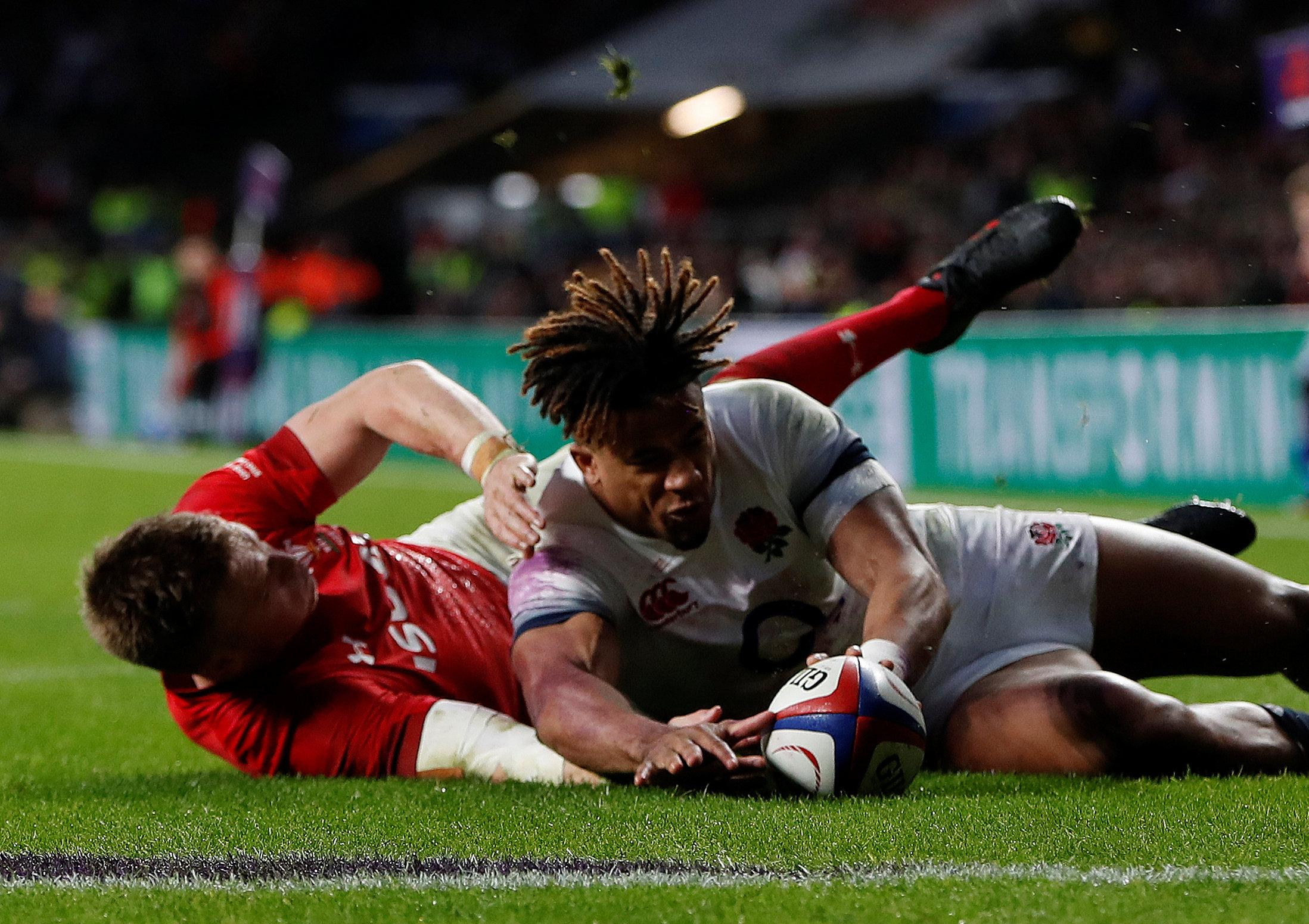 Gareth Anscombe reached the ball ahead of Anthony Watson but Wales were denied a try