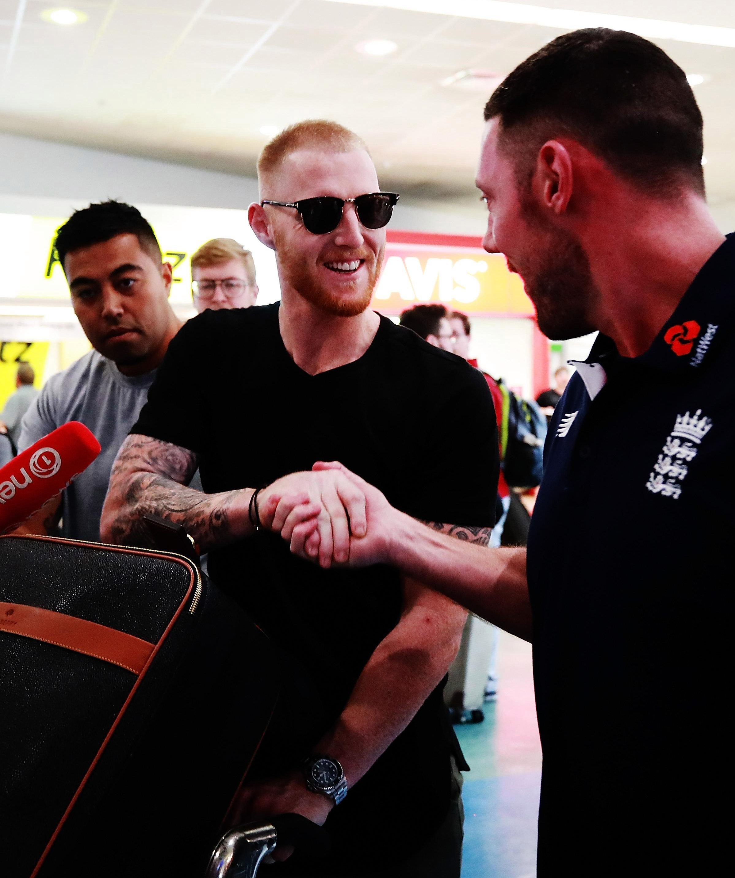 Ben Stokes shook hands with England staff members after touching down in Auckland