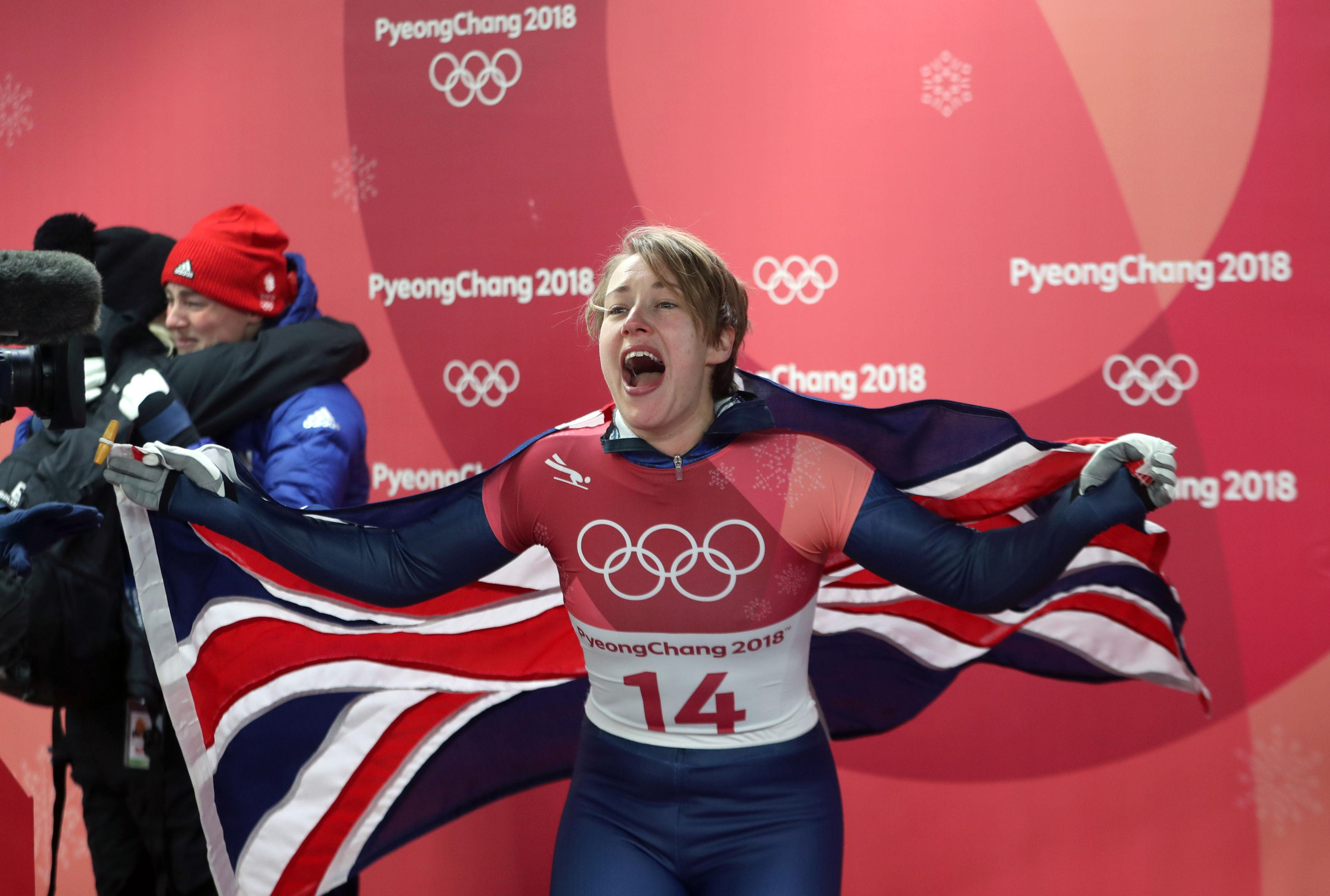 Yarnold screams with delight as she realises she has defended her Olympic skeleton title