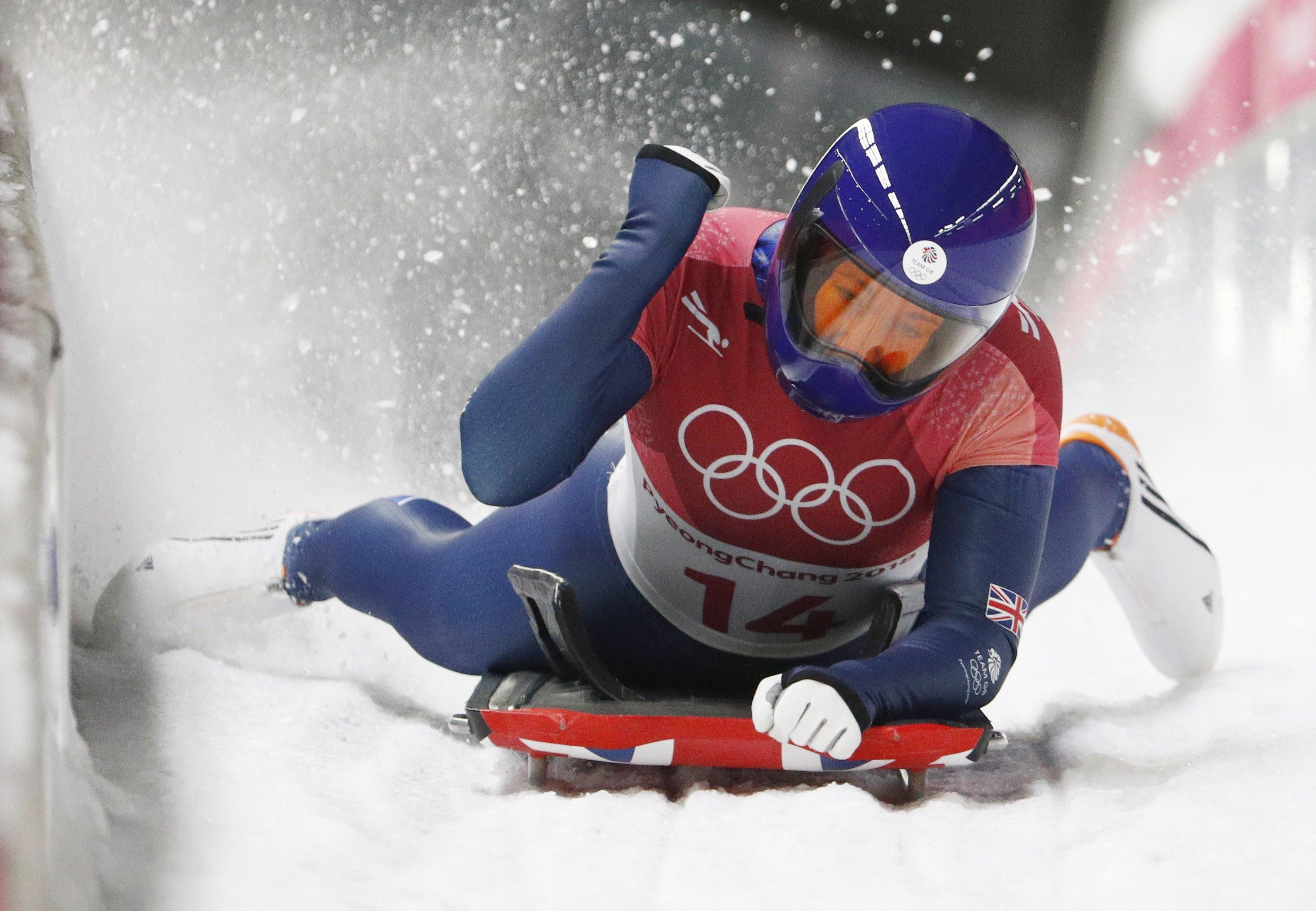 Lizzy Yarnold pumps the air with delight after her stunning final run led to Olympic gold