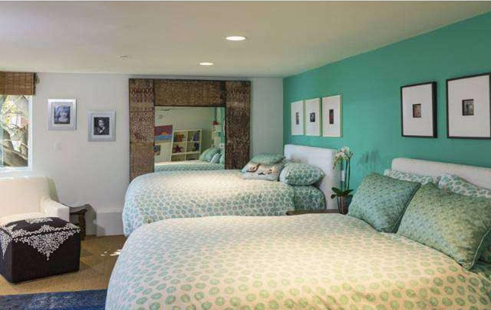 All three guest bedrooms have ocean views and the penthouse-level master bedroom even has a balcony