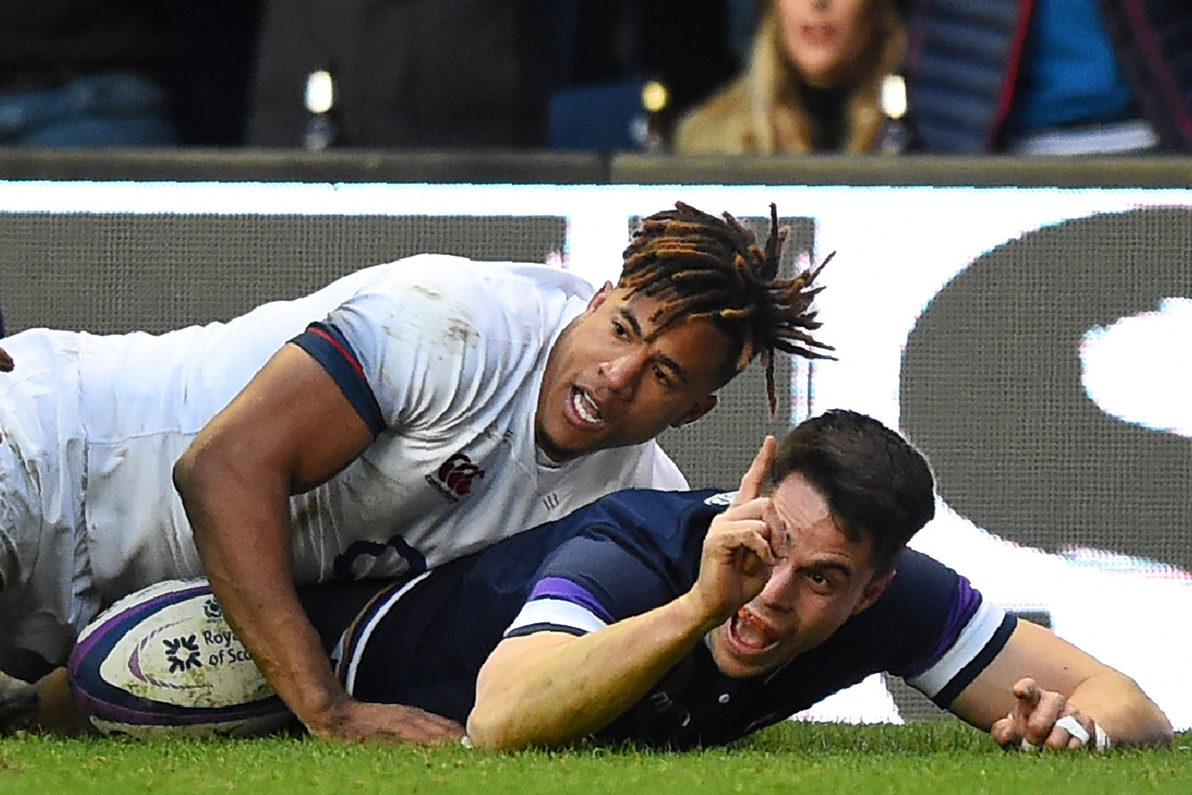 Scotland's wing Sean Maitland (R) celebrates after scoring their second try