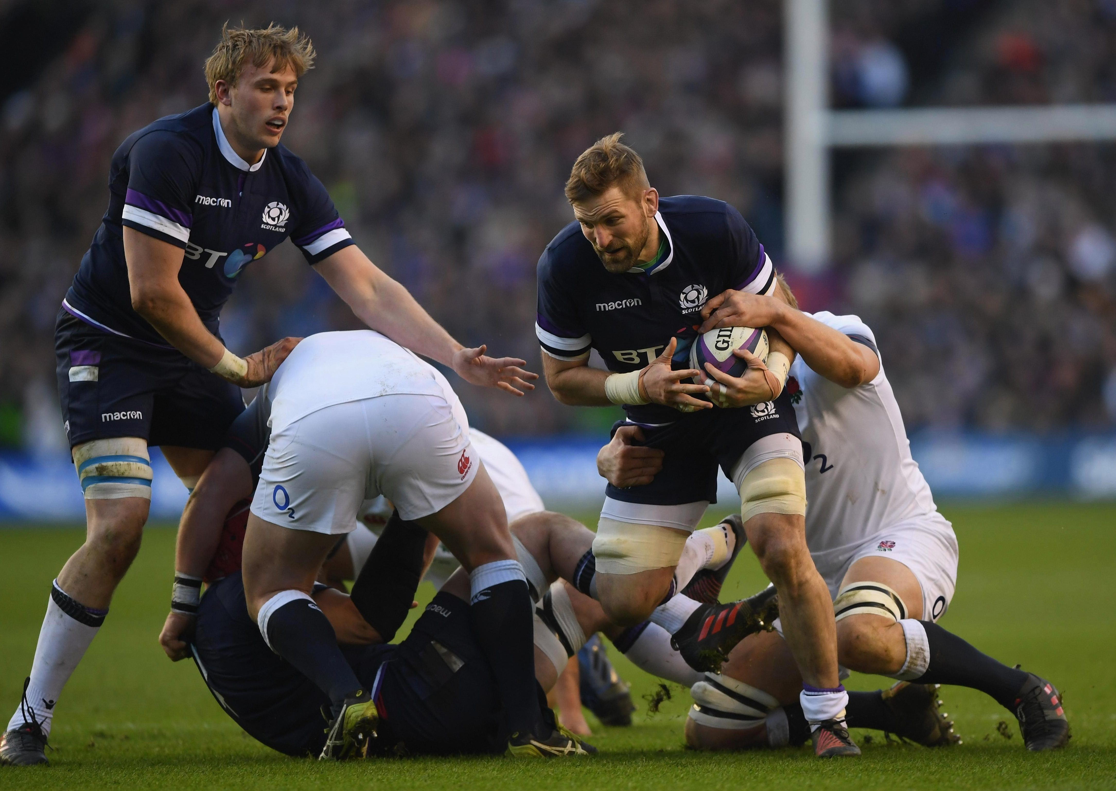Scotland star John Barclay is tackled by Joe Launchbury but England mostly struggled against the fired-up home side on Saturday