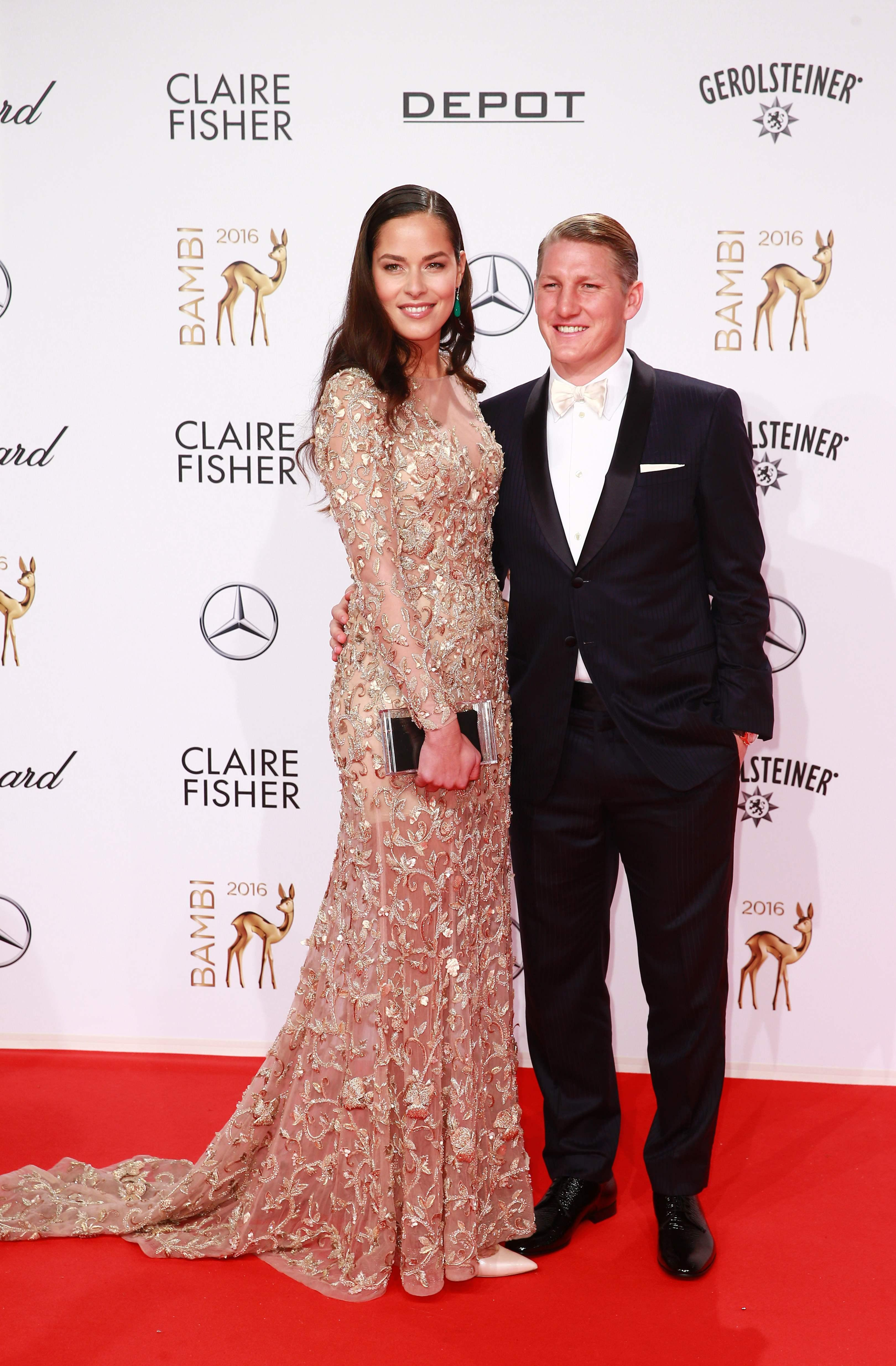 Ivanovic looks stunning in a gold dress next to husband Schweinsteiger