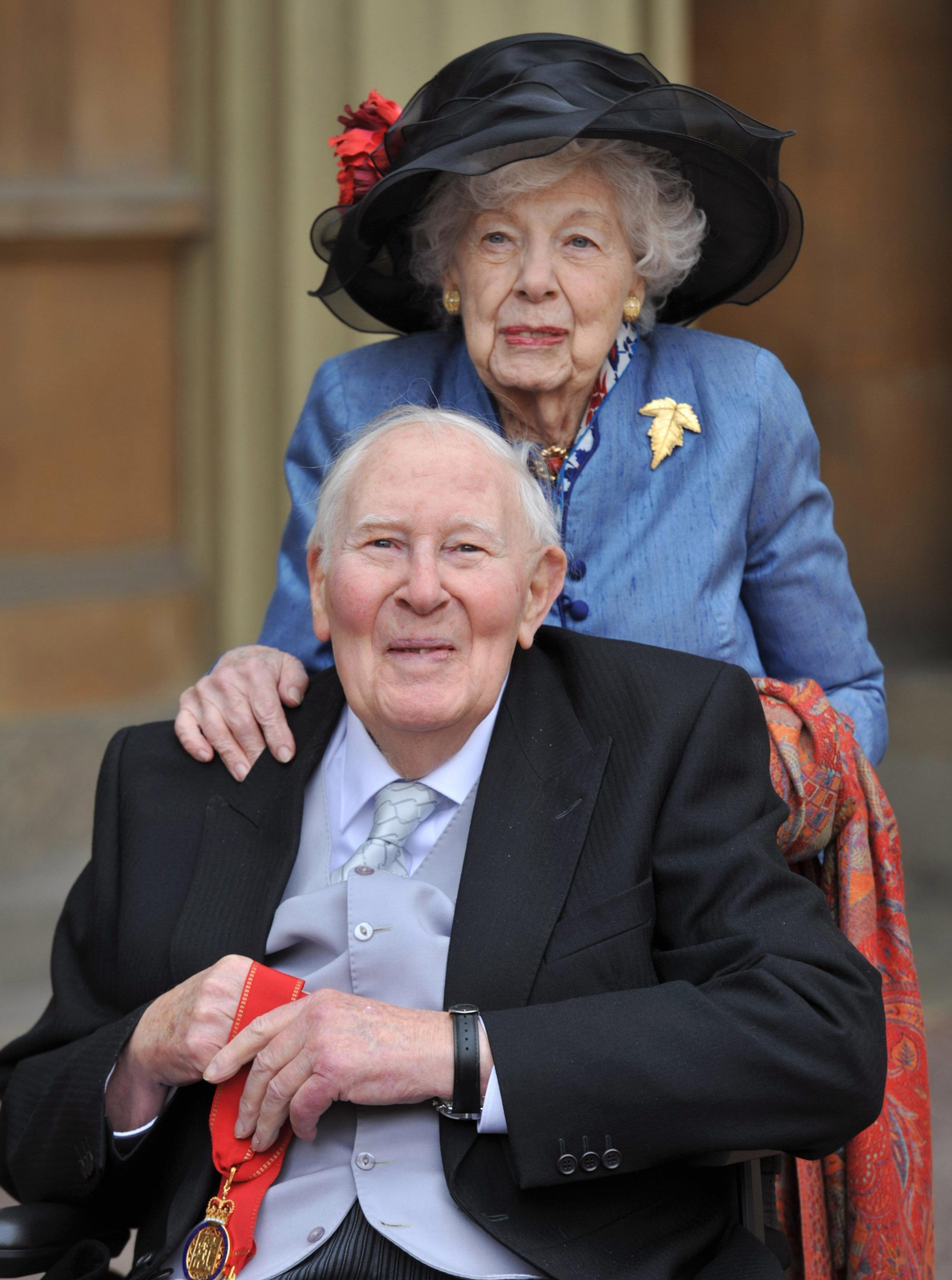 Sir Roger with wife Moyra last year at Buckingham Palace where he was awarded a Companion of Honour from the Duke of Cambridge