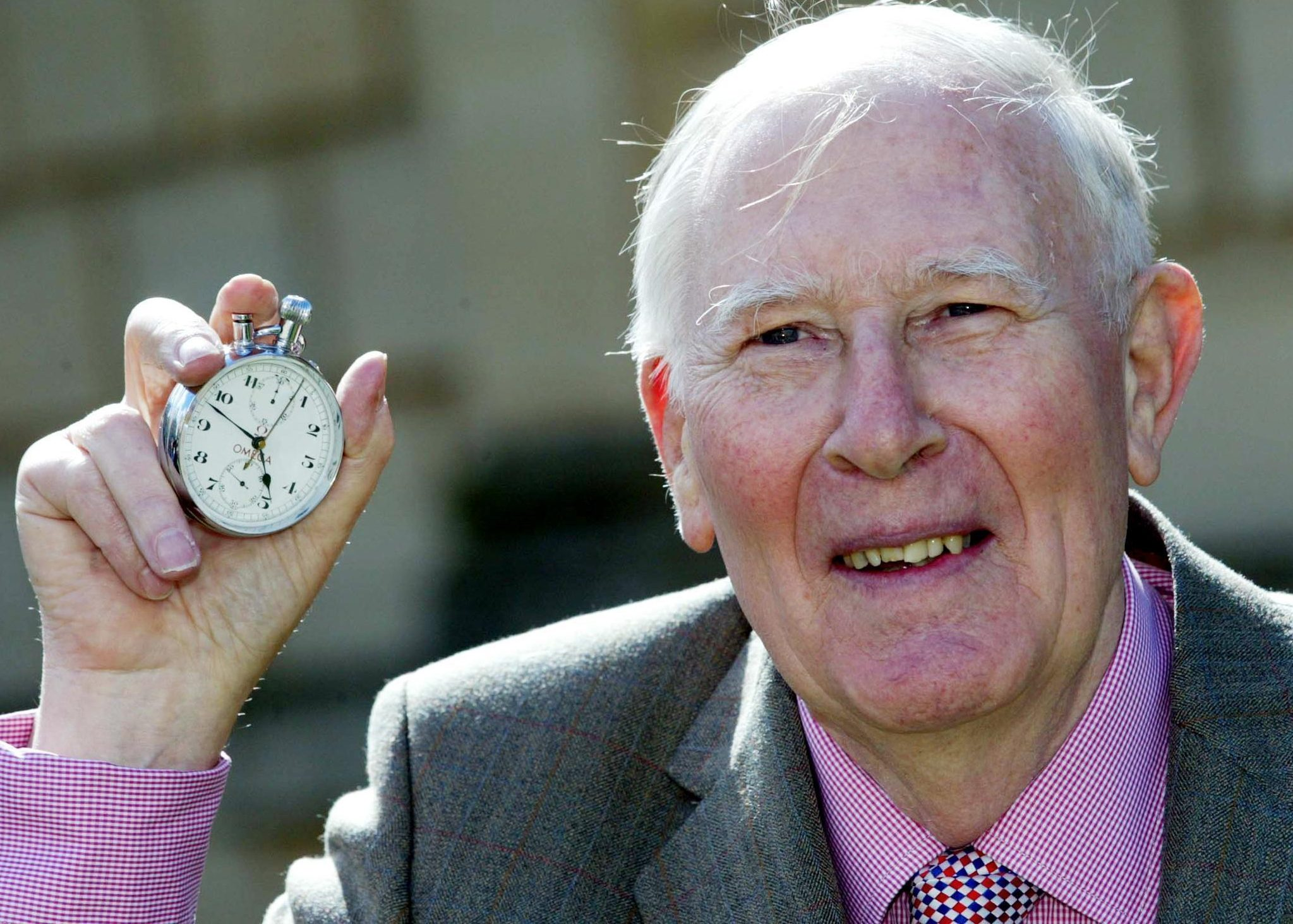Sir Roger Bannister with the stopwatch that recorded his record feat in 1954