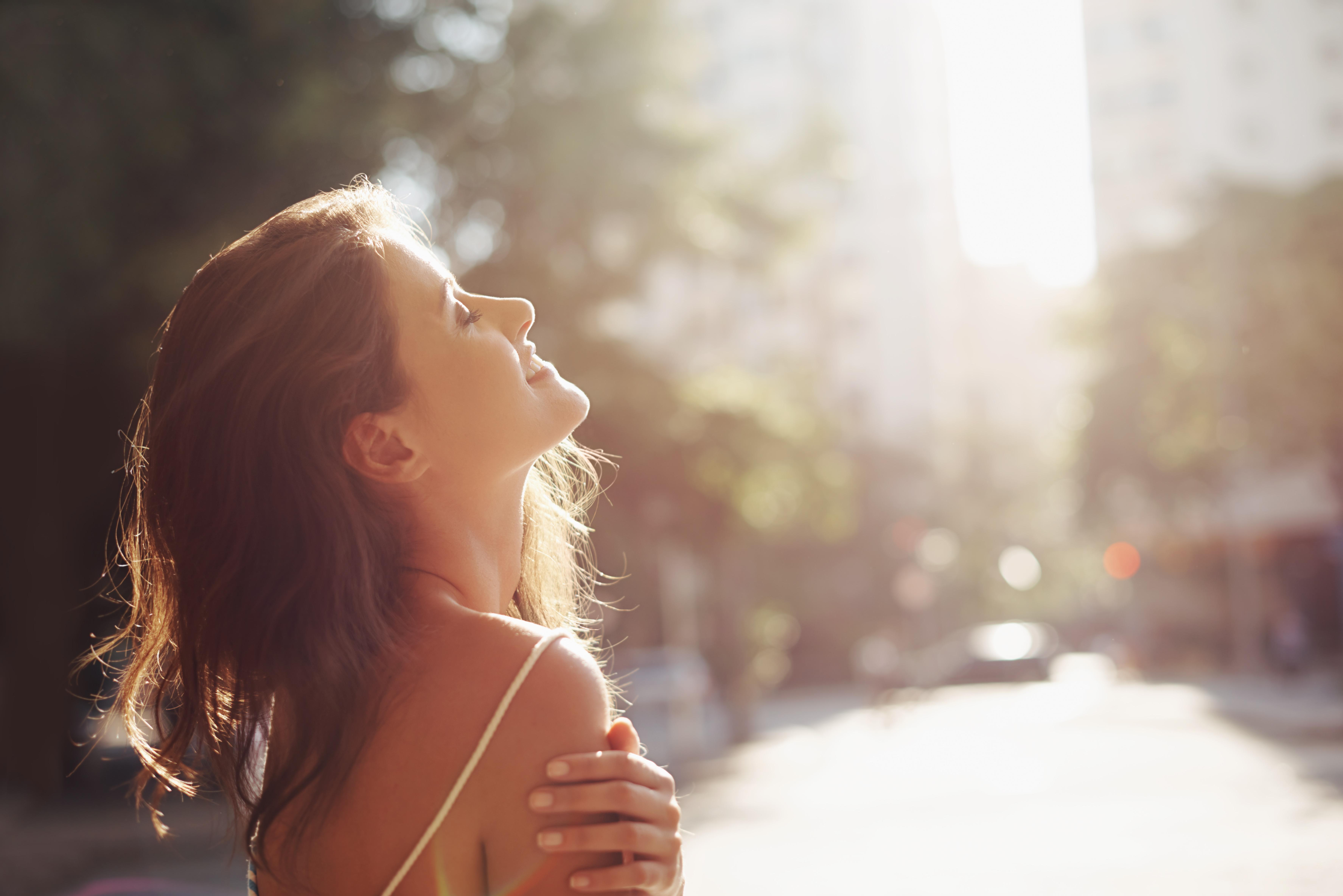 Time in the sun 'slashes cancer risk by half and boosts vitamin D levels'