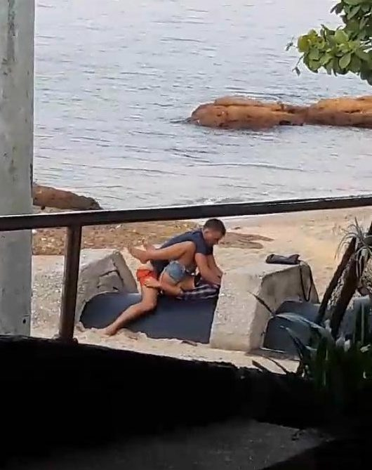 The loved-up couple pictured romping on the beach in Pattaya
