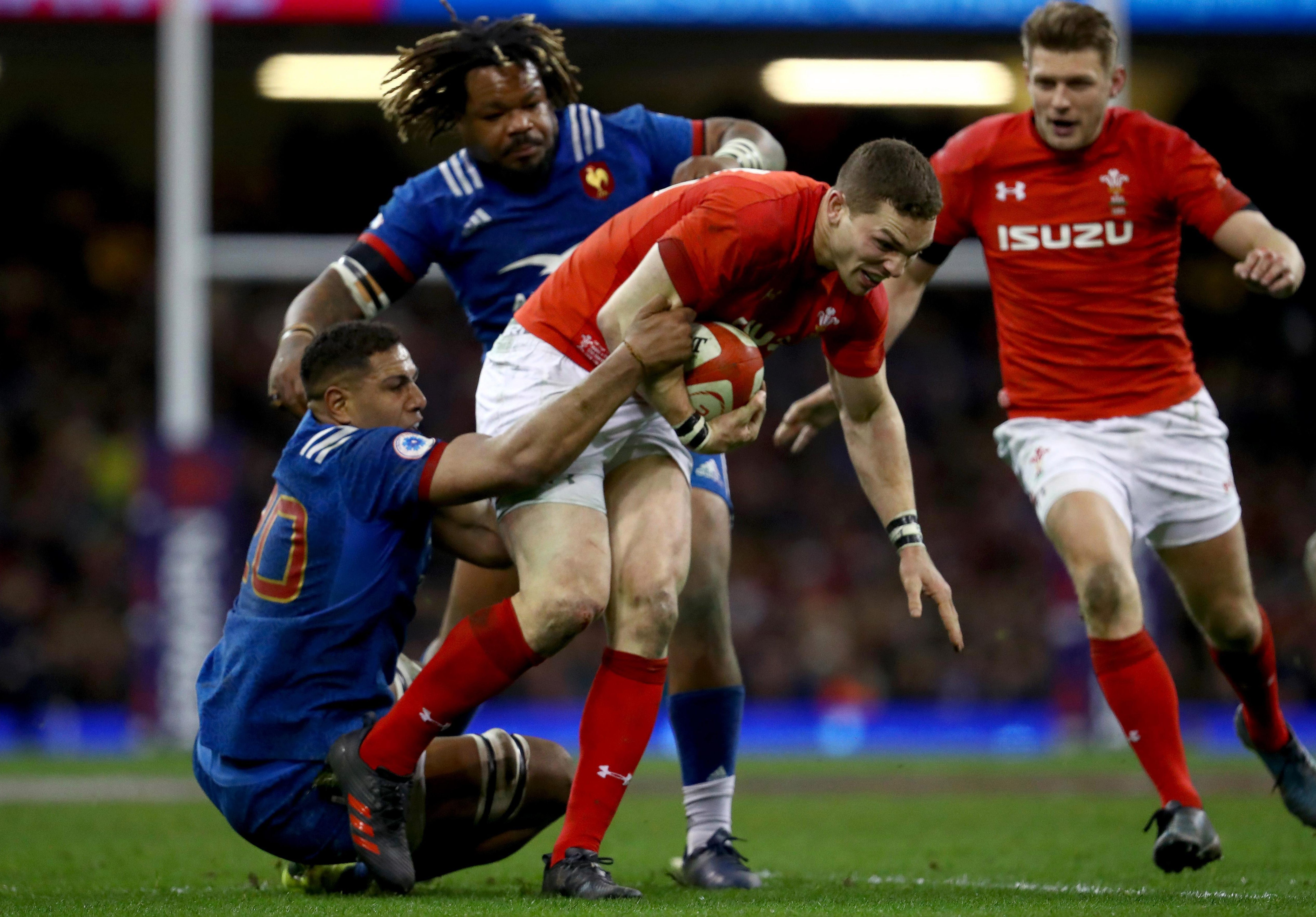 North evades a tackle from Mathieu Babillot in Wales' Six Nations clash with France