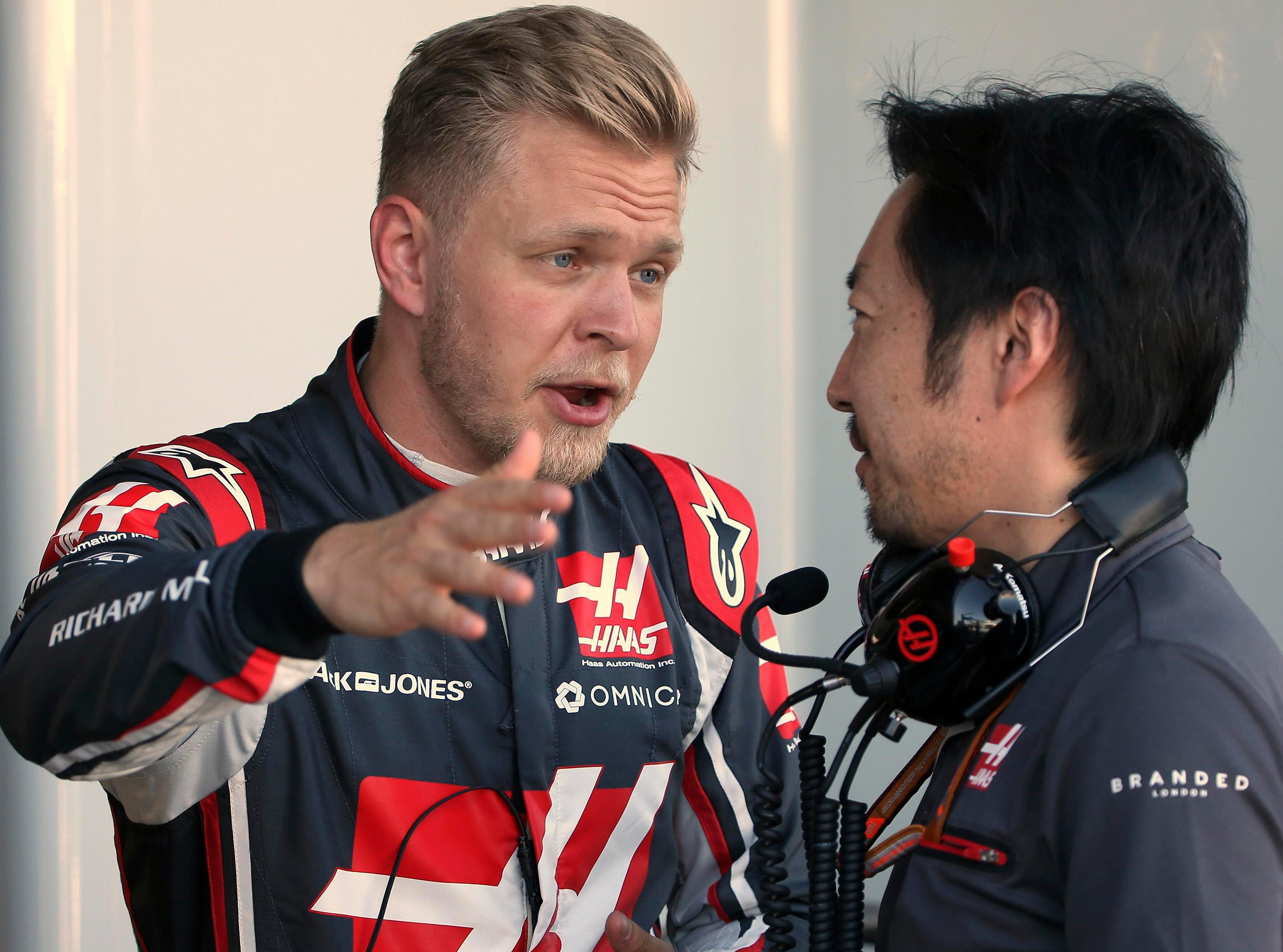 Magnussen talks to an engineer in the garage during practice for the Australian GP