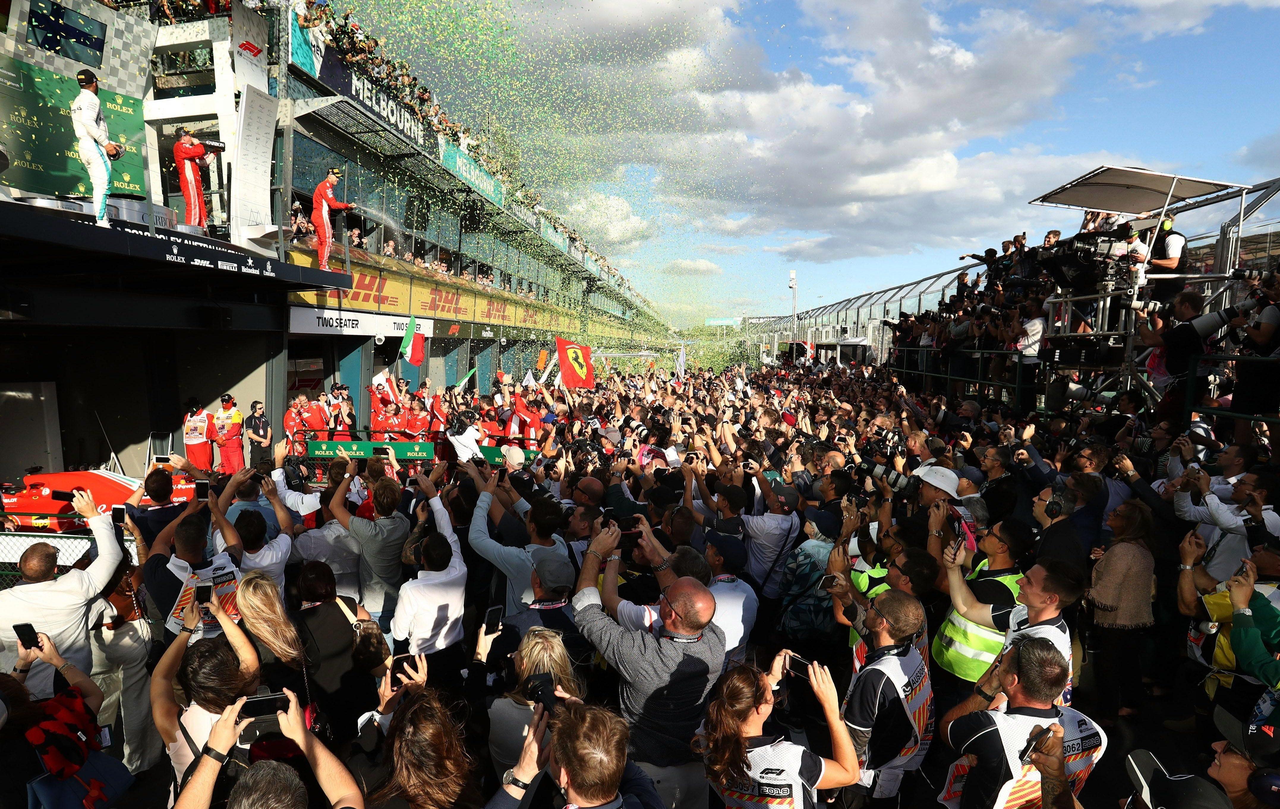 Fans watch in Melbourne as Sebastian Vettel celebrates winning season opener