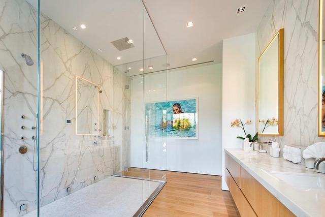 The plush main bathroom features a double walk-in shower