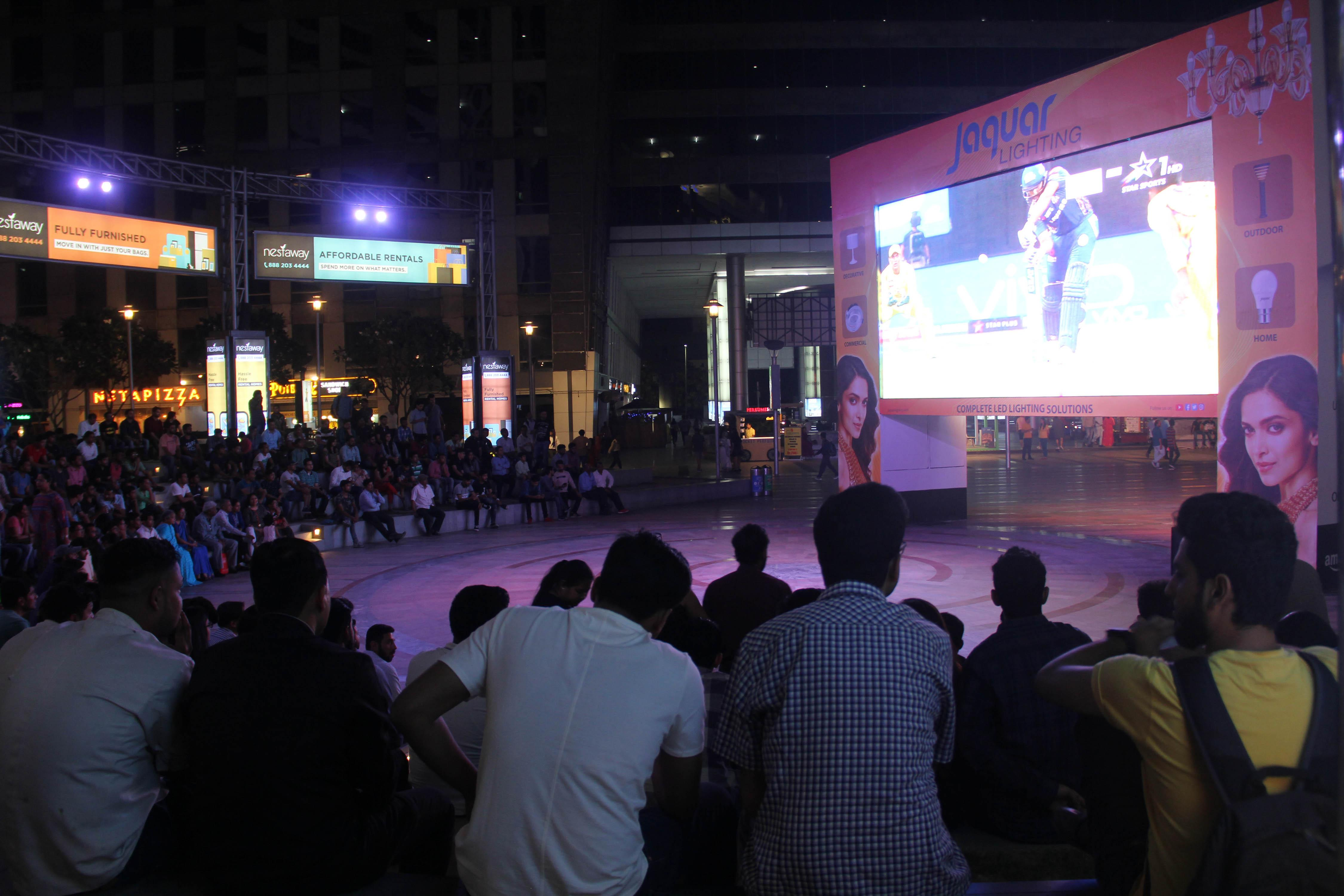 Fans in Delhi watch the action a big screen in the city