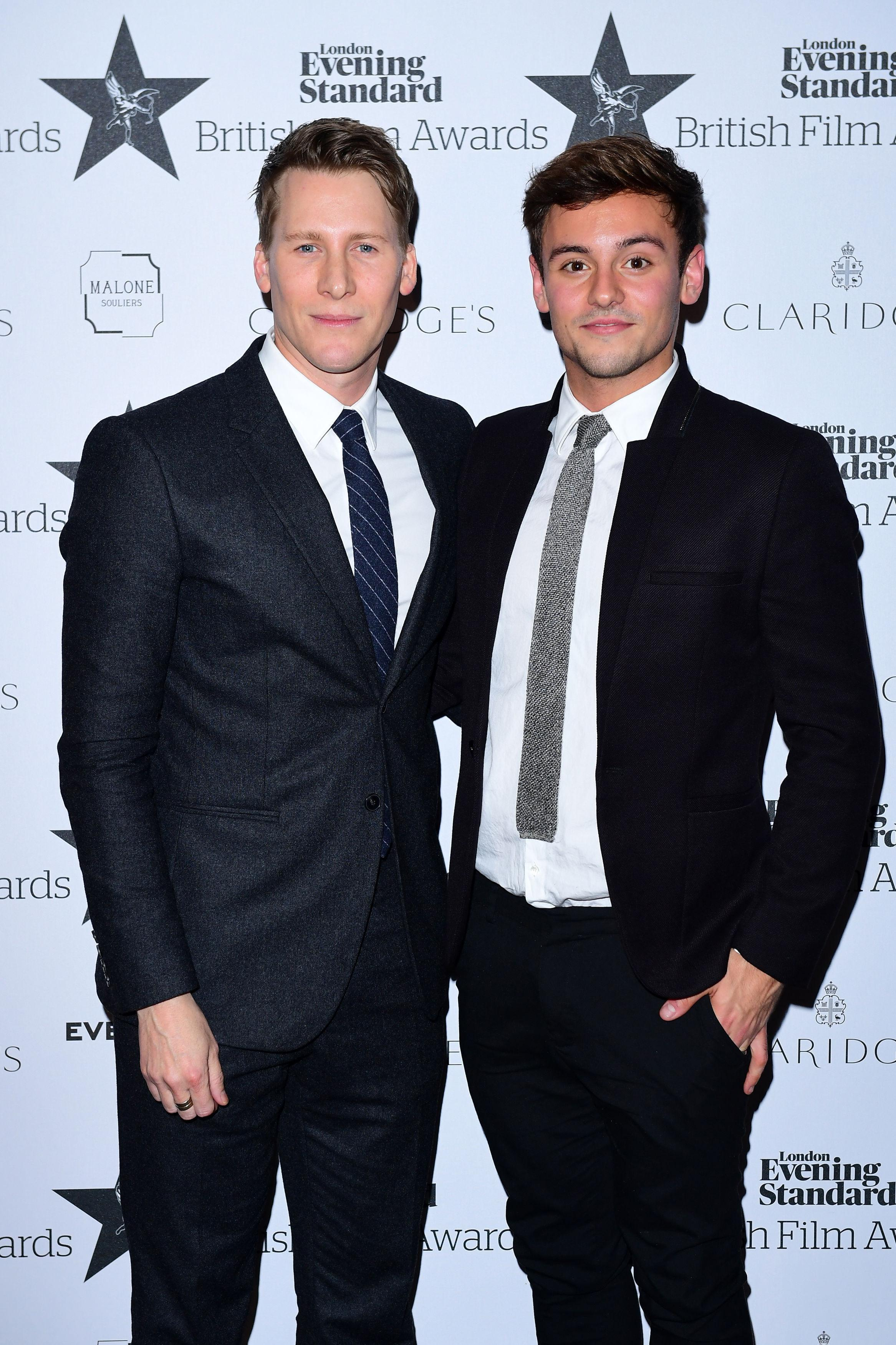 Tom Daley, right, pictured with husband Dustin Lance Black after they tied the knot last year