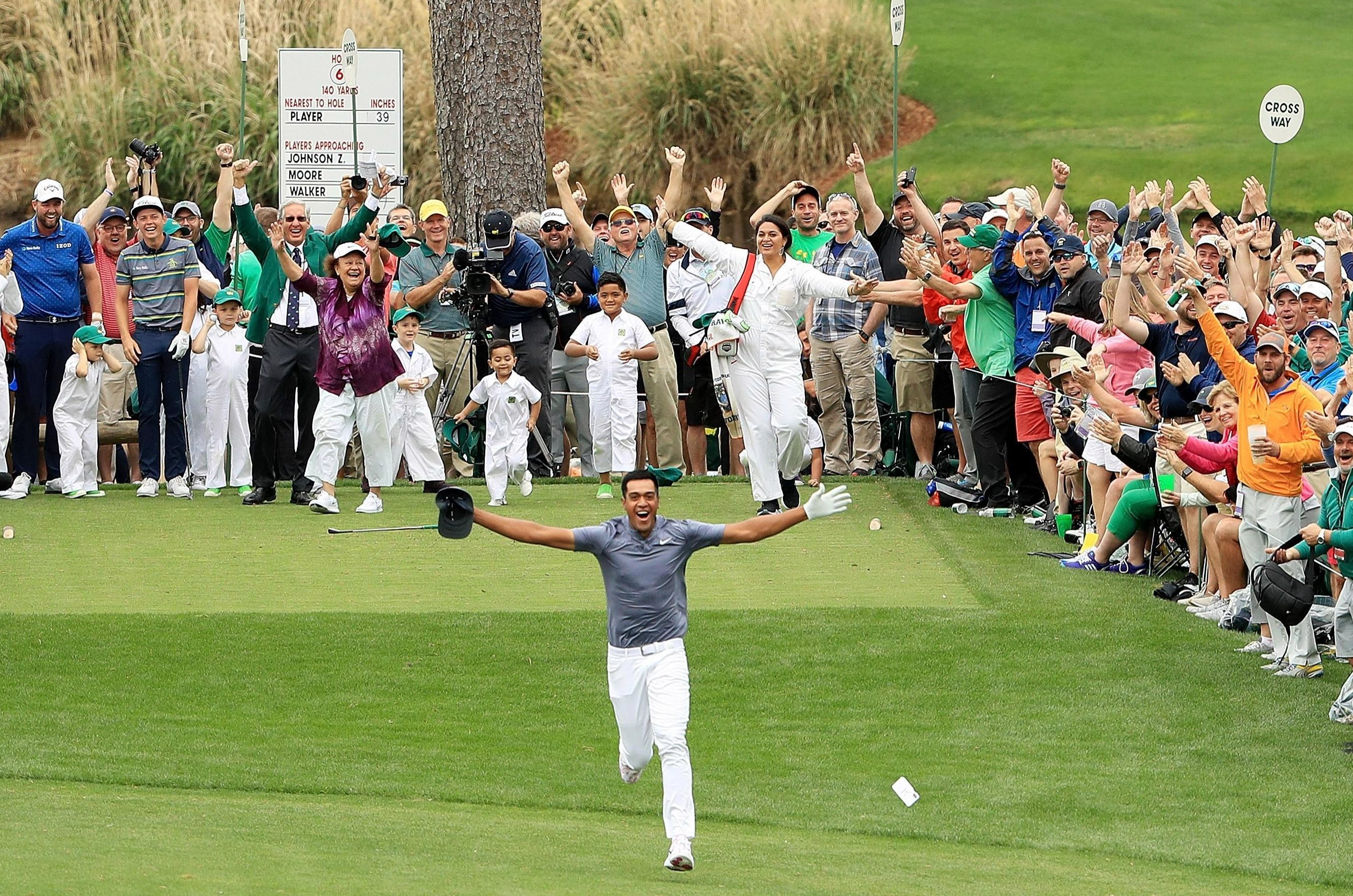 Tony Finau dashed down the fairway lapping up the applause after his ace on the seventh in the Masters Par Three tournament