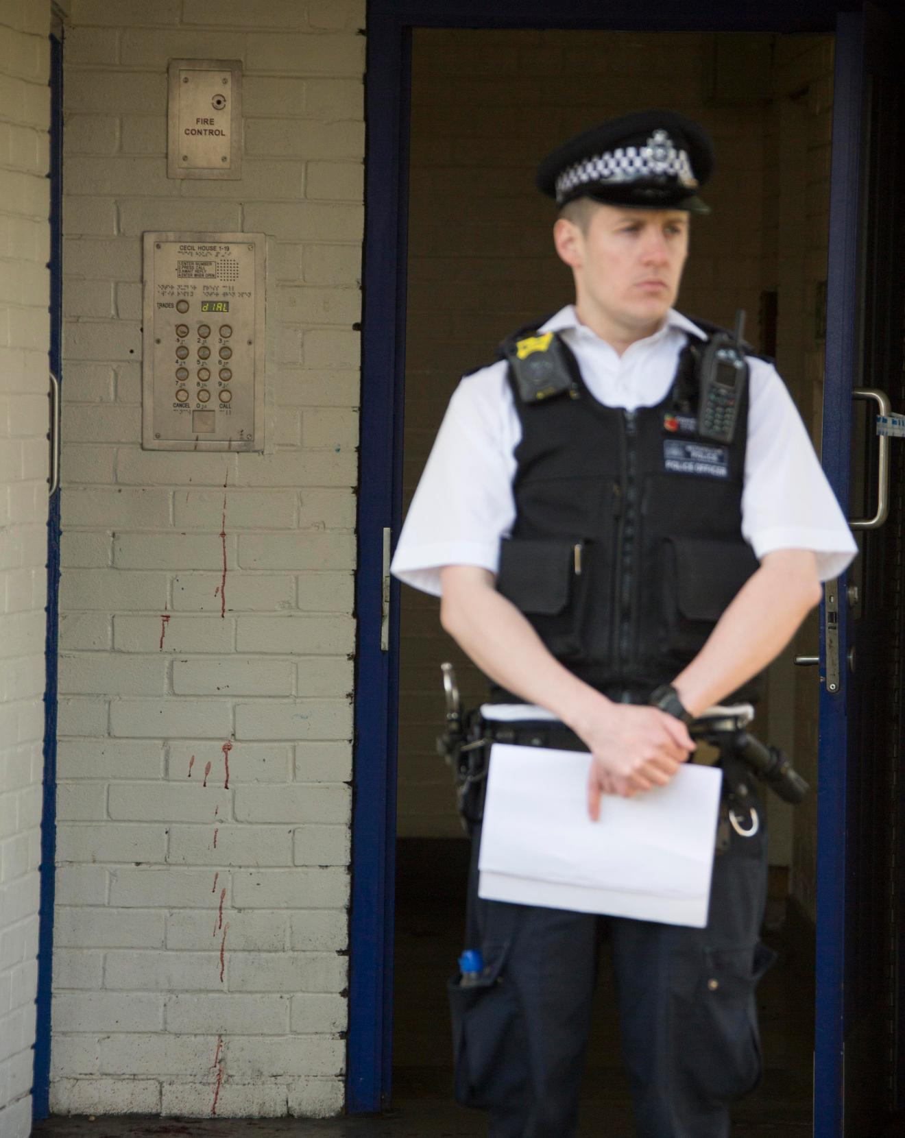 Blood is pictured dripping down a wall after the lunchtime stabbing in Walthamstow