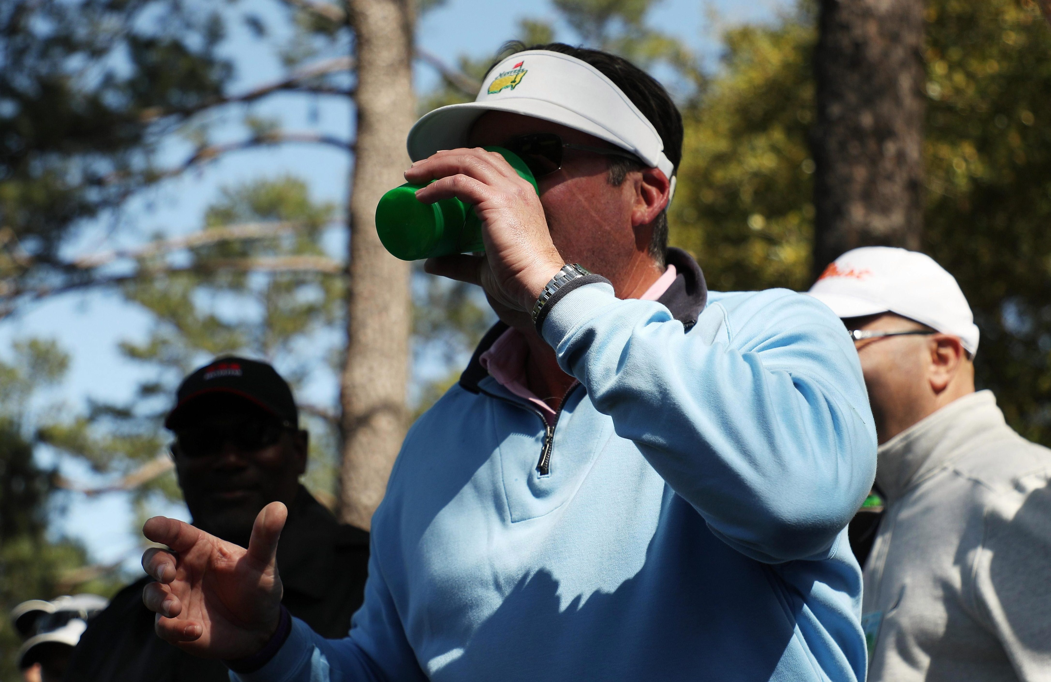 The spectator chugged his beer