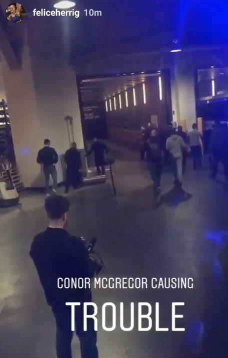 A burly security guard managed to stop the gate reaching the bus as McGregor was thwarted