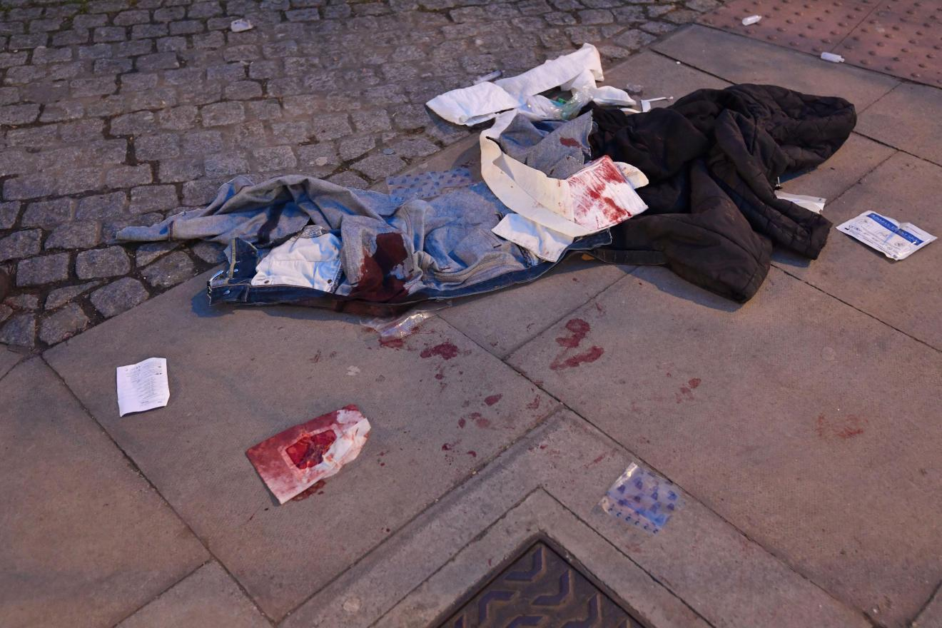 Bloodied clothes pictured at the scene of the triple stabbing in Mile End