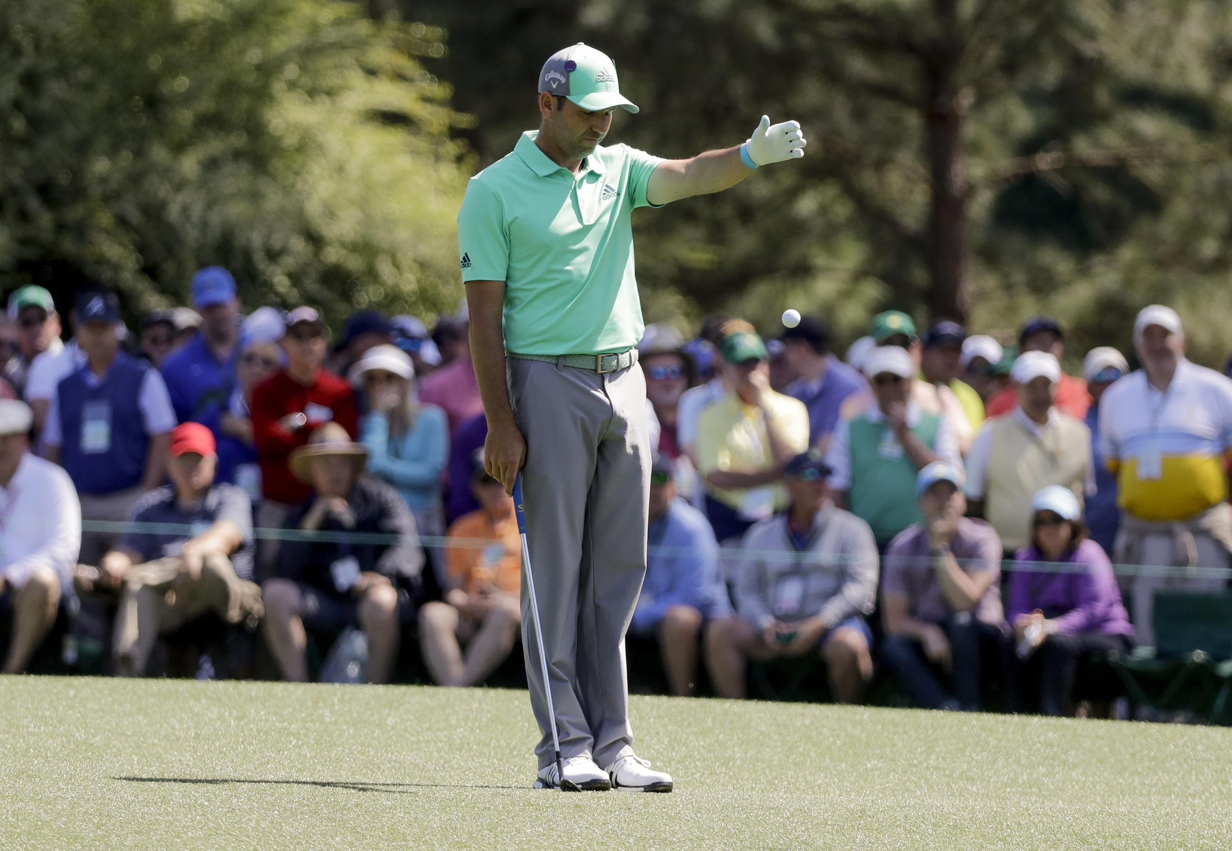 Garcia takes a drop on his way to scoring 13 on the par-five 15th hole